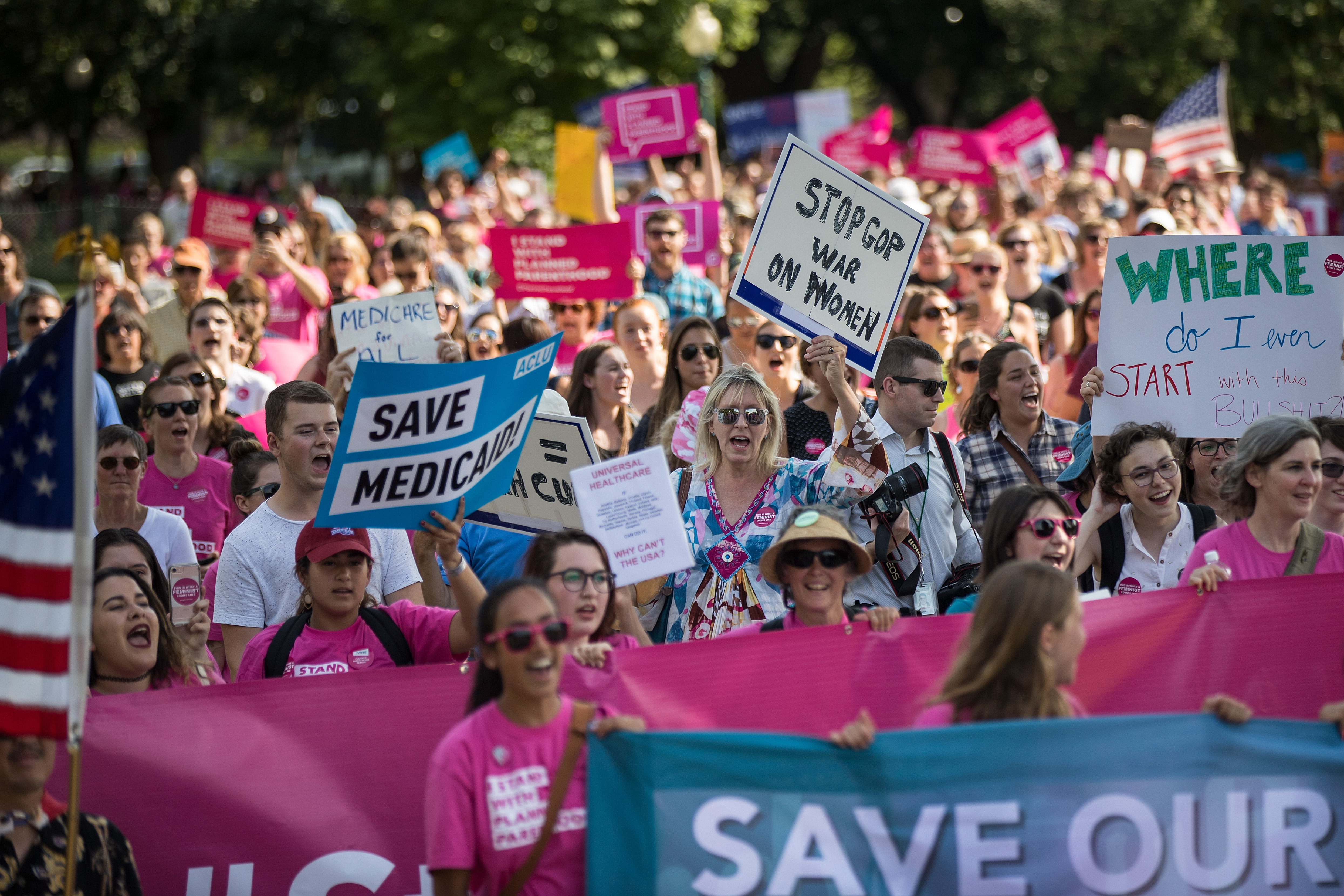 Activists march around the U.S. Capitol to protest the Senate GOP health care bill, on Capitol Hill, June 28, 2017 in Washington, DC.