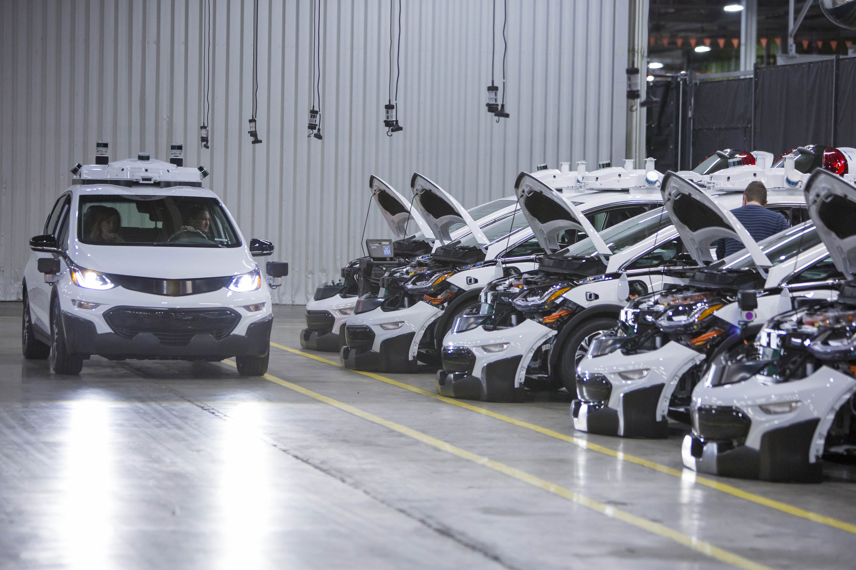 Chevrolet Bolt EV autonomous test vehicles are assembled at General Motors assembly plant. Lyft is working on a stack software to run self-driving car fleets.