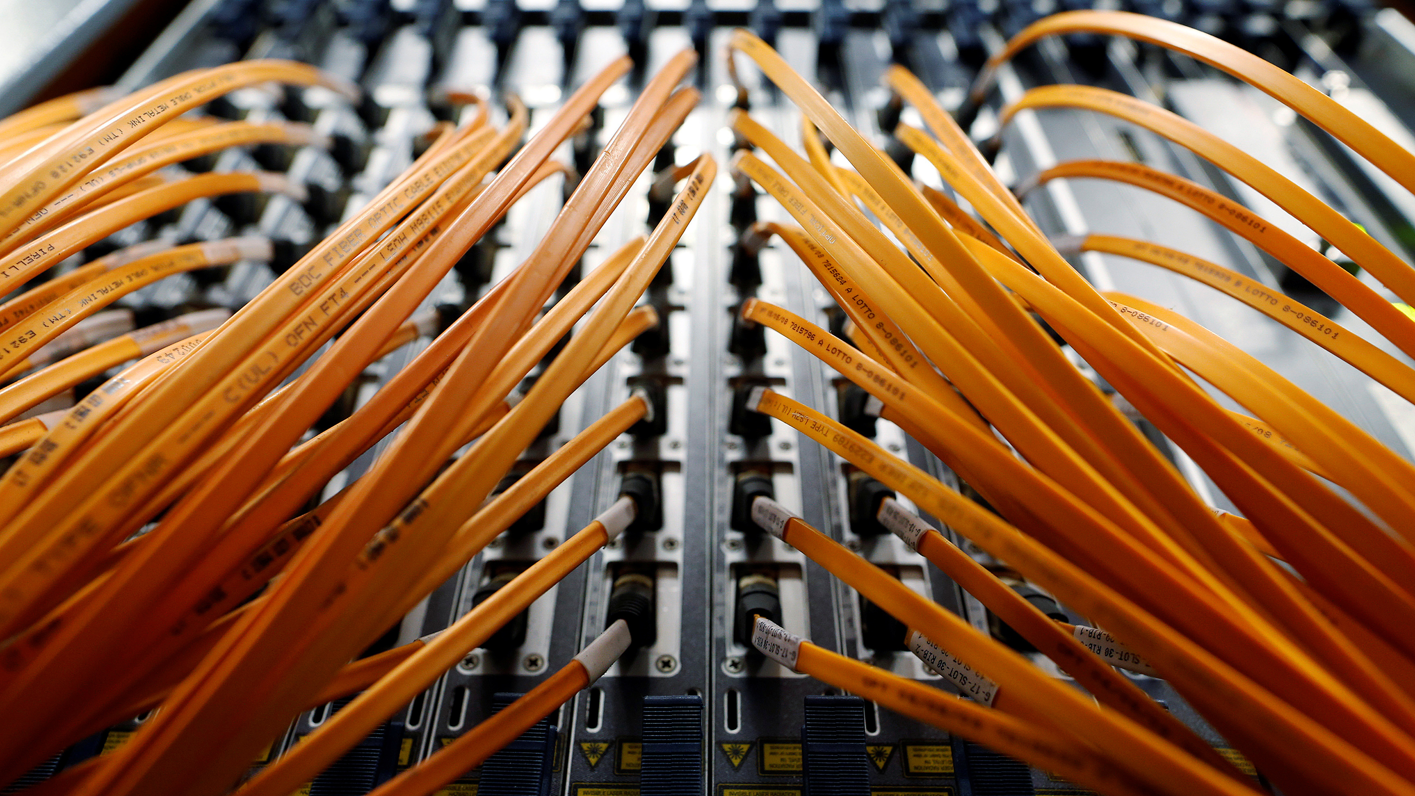 Optical fibre cables of Telecom Italia are seen in a telephone exchange in Rome