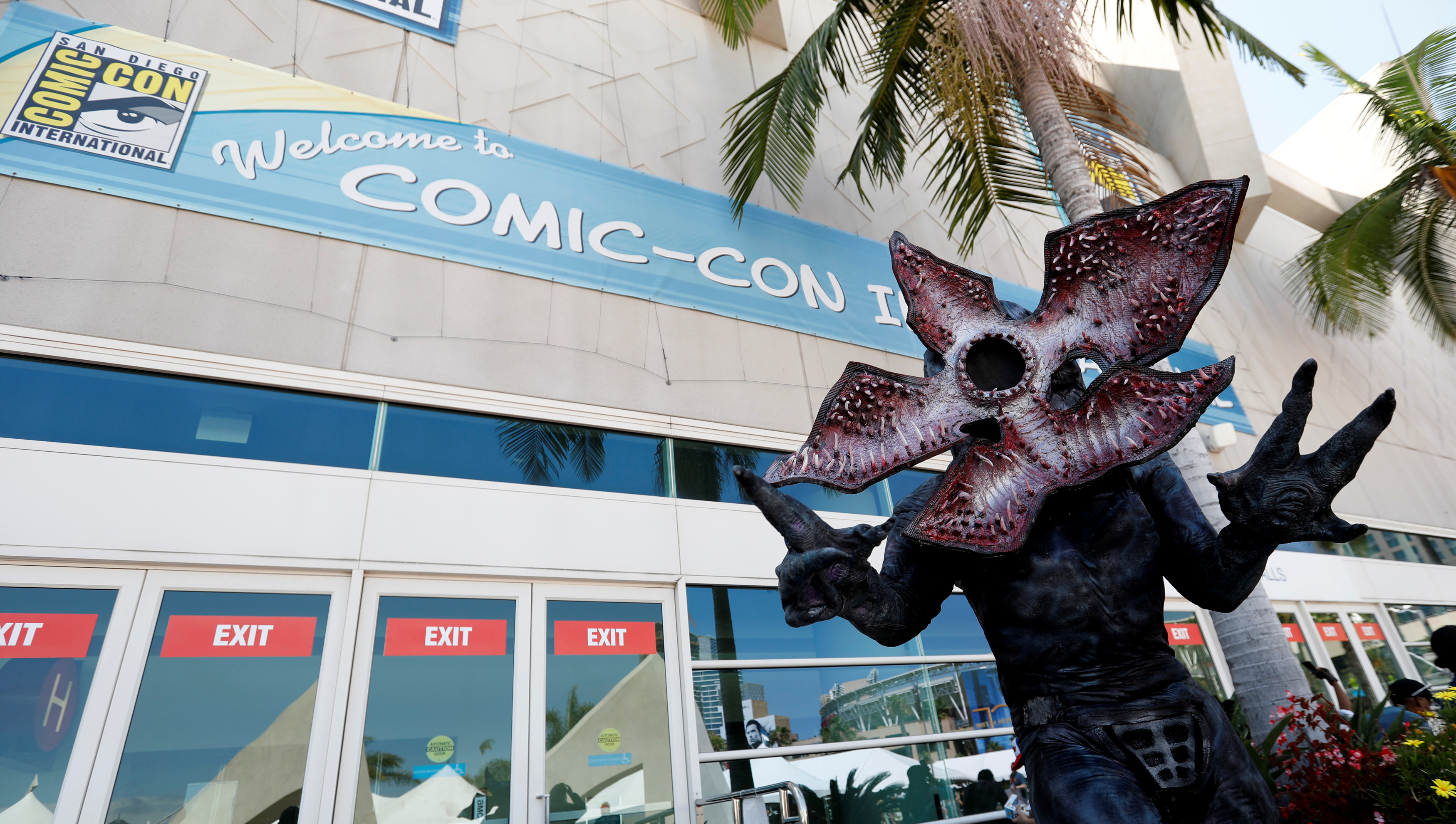 "Schoelen poses dressed like the character of Demogorgon from ""Stranger Things"" during the 2017 Comic-Con International Convention in San Diego"
