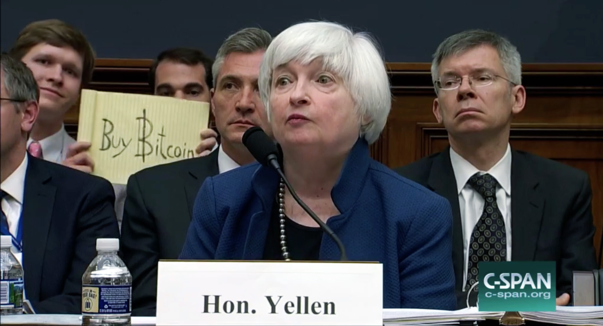 Bitcoin enthusiasts photobombed Federal Reserve chair Janet Yellen as she testified in front of Congress Wednesday, July 12, 2017.