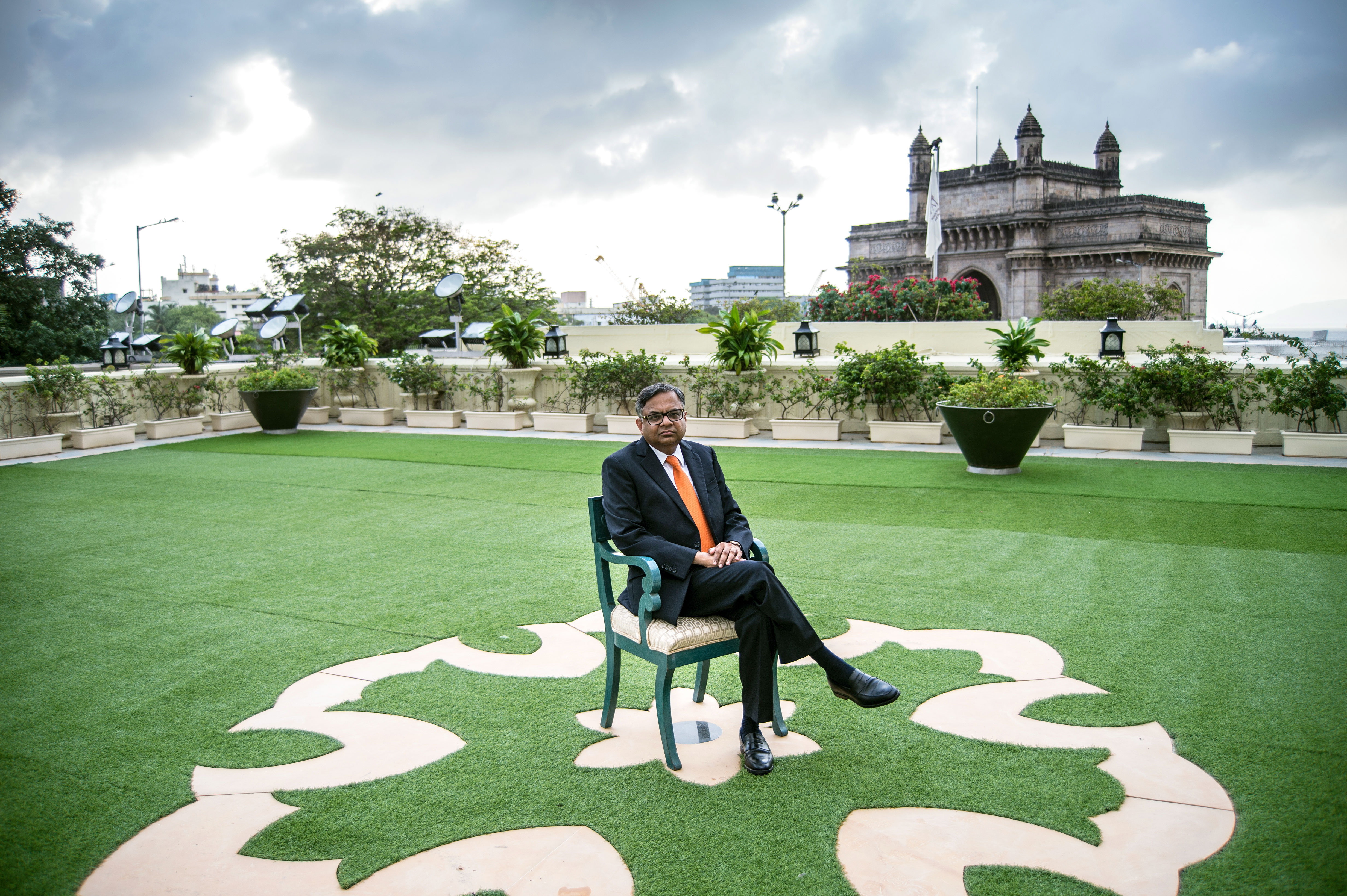 "Natarajan ""Chandra"" Chandrasekaran on the roof of the Taj Mahal Palace Hotel in Mumbai, with the Gateway of India monument in the background. As a chairman of Tata Sons, he oversees a sprawling conflomerate with some 700,000 employees and more than $100 billion in revenue."
