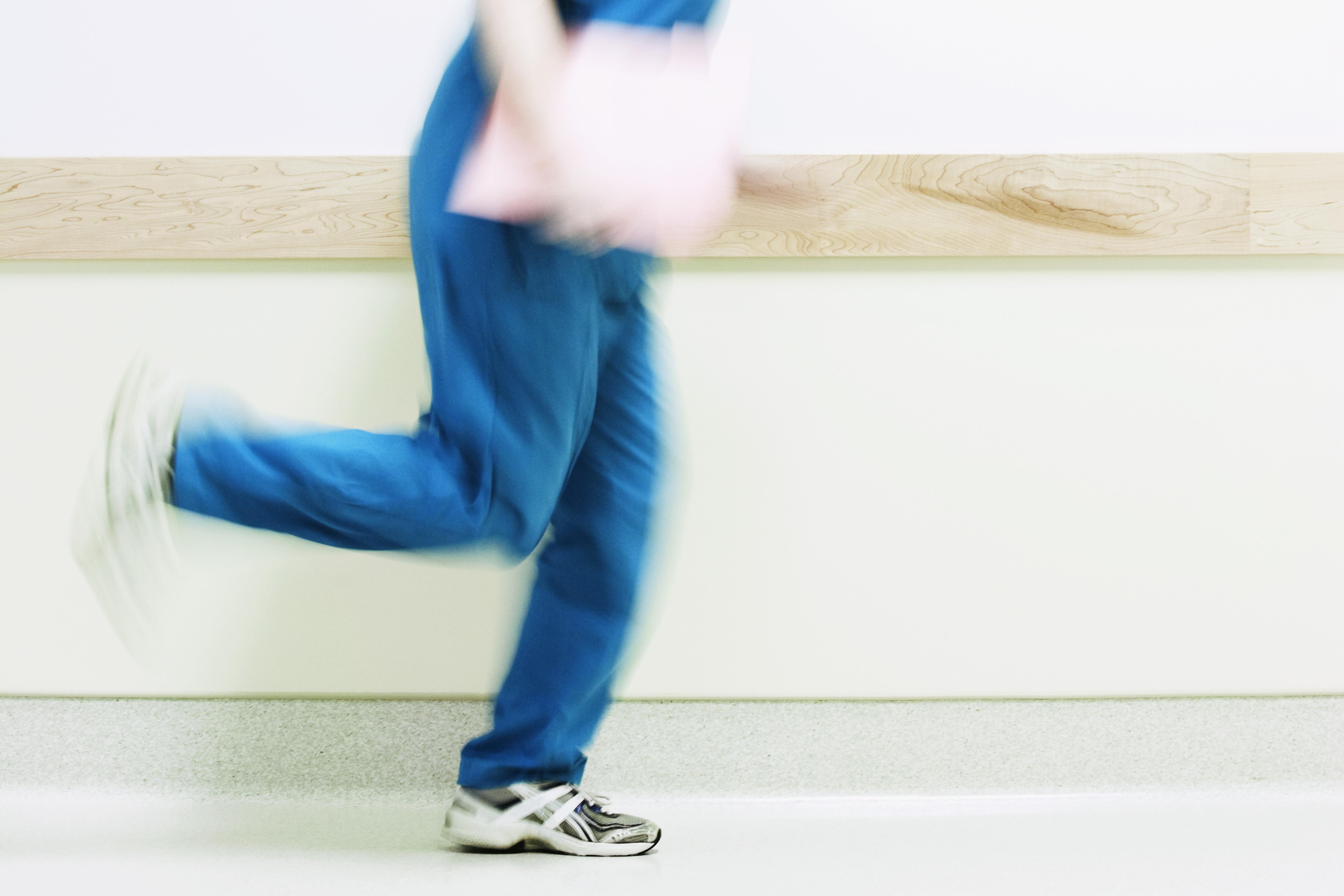Female nurse running in a hospital