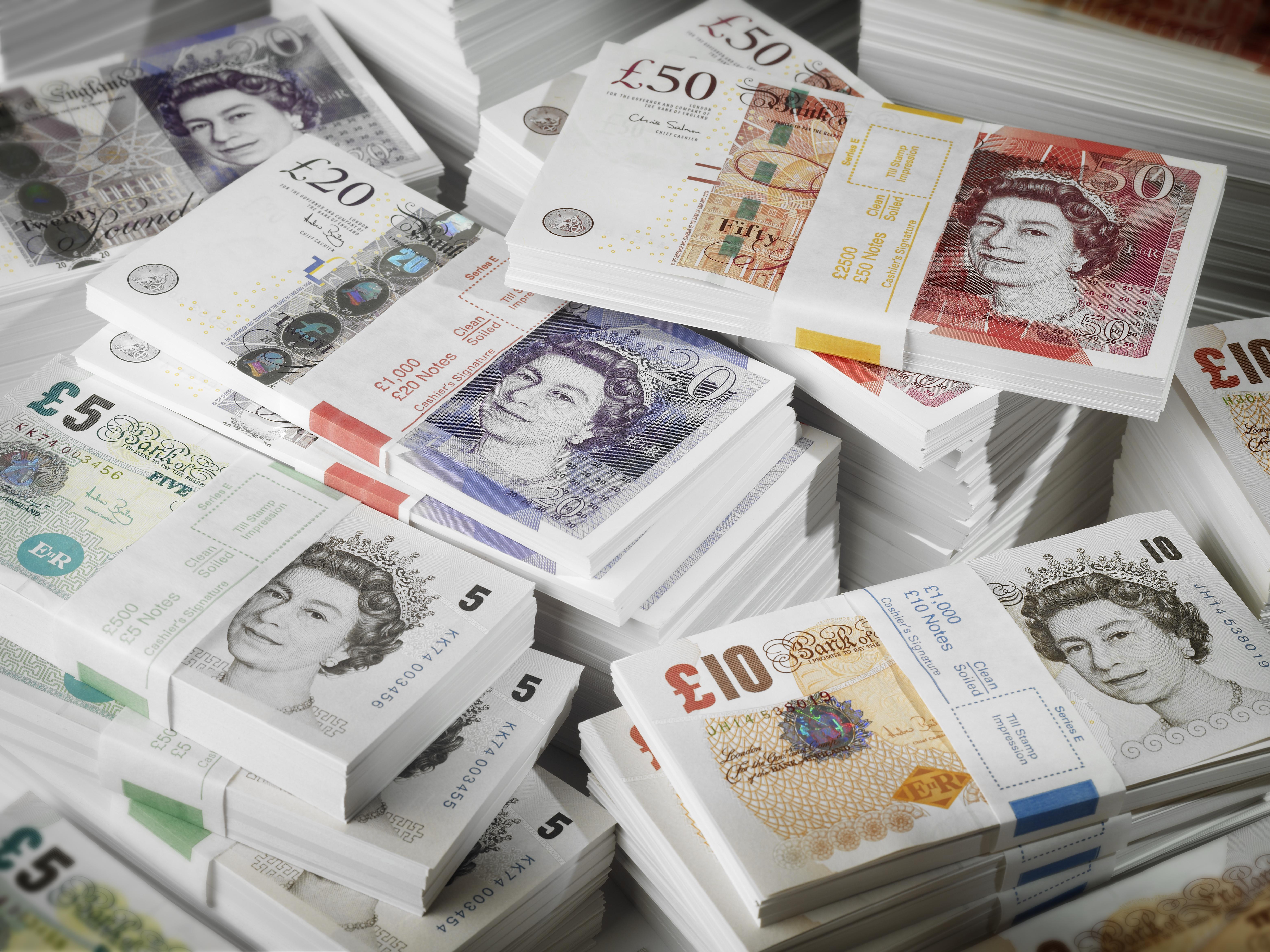Bundles and Piles of UK Banknotes