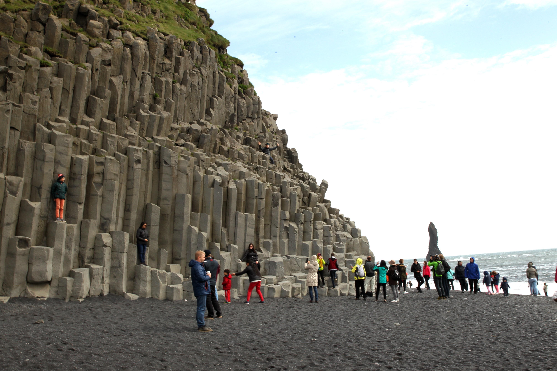 Tourists visit Black beach in Vik, Iceland on June 13, 2017.
