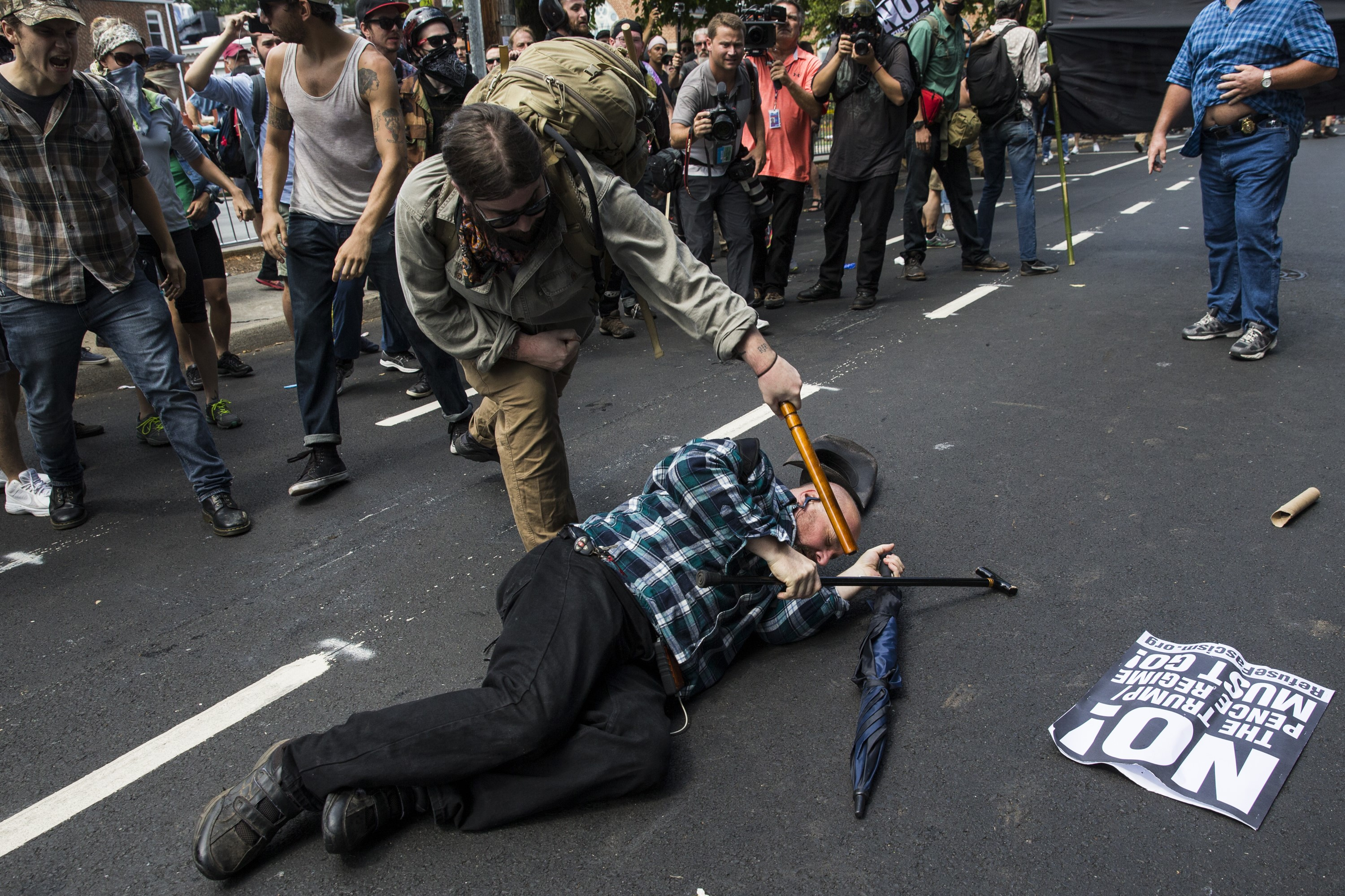 A counter protester strikes a White Nationalist with a baton during clashes at Emancipation Park where the White Nationalists are protesting the removal of the Robert E. Lee monument in Charlottesville, Va., USA on August 12, 2017.