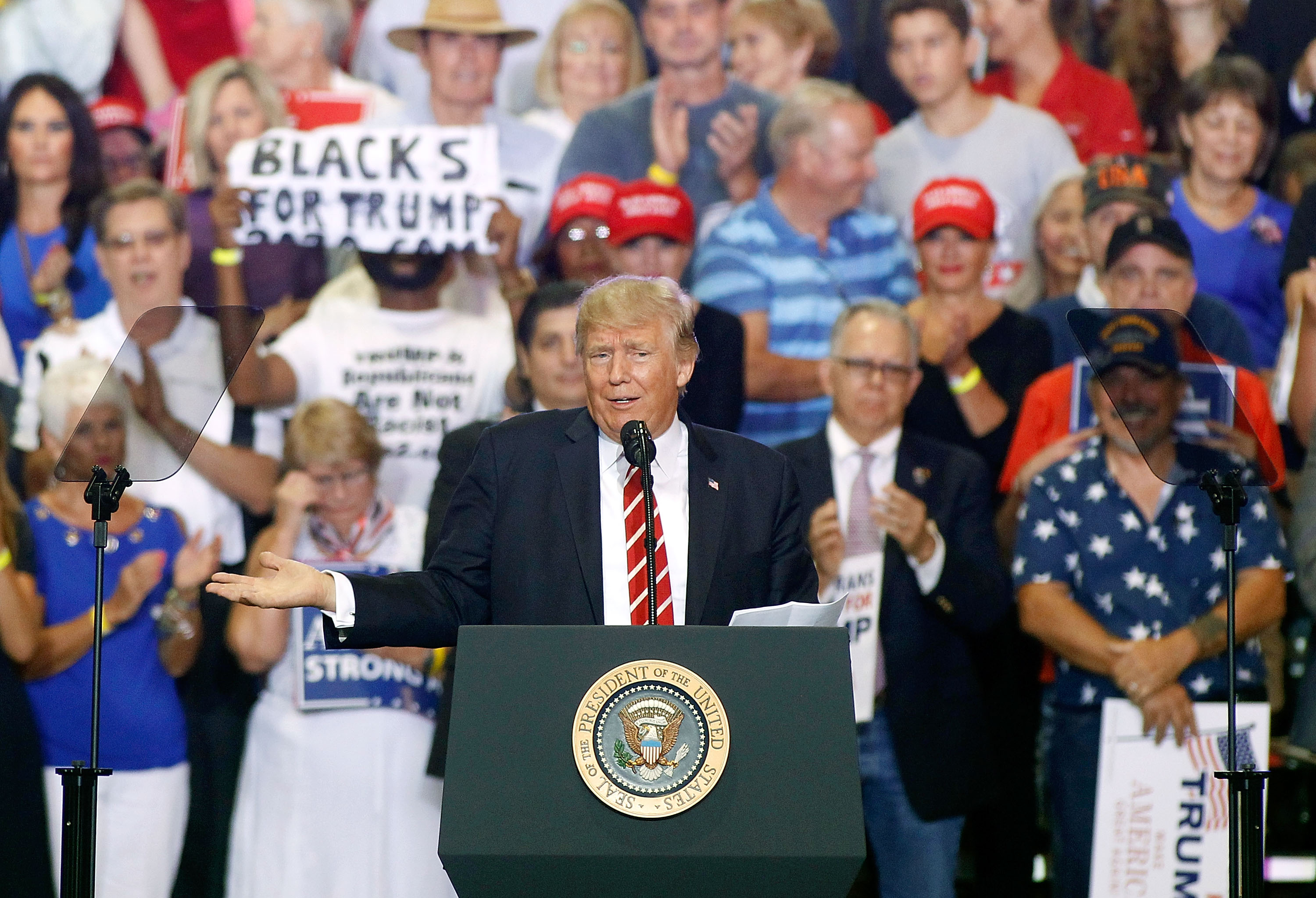 U.S. President Donald Trump gestures to the crowd as he speaks to supporters at the Phoenix Convention Center during a rally on August 22, 2017 in Phoenix, Arizona.