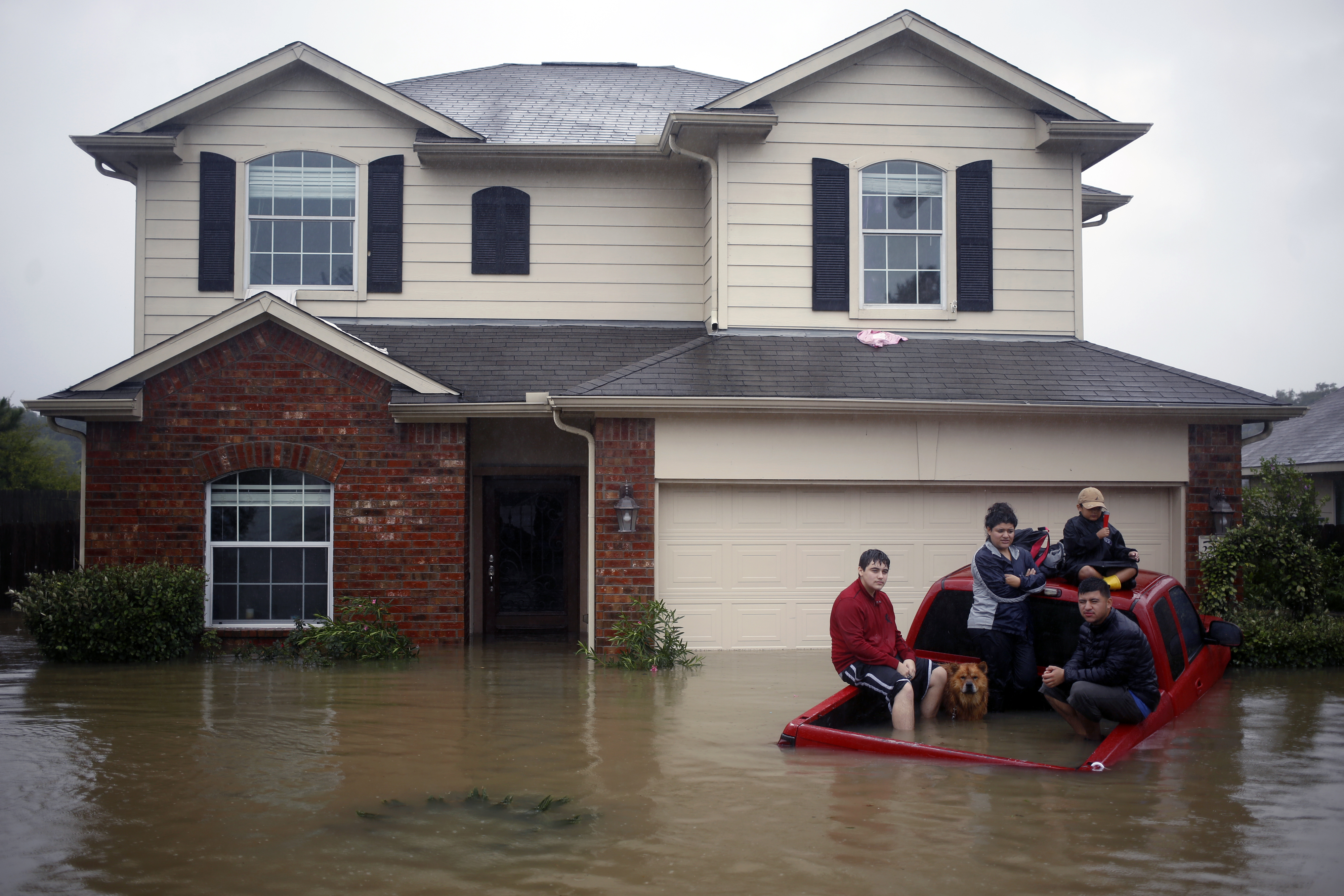 Flooding As HarveyPlunges Houston's Thriving Economy Into Years-Long Crisis