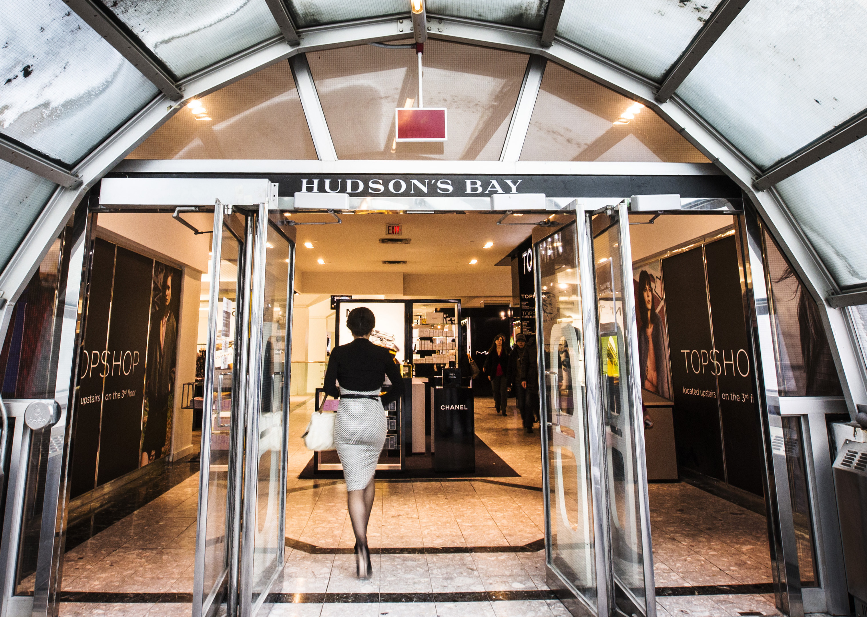 A man walks through the doors at the Hudson's Bay Company (HBC) flagship department store in Toronto