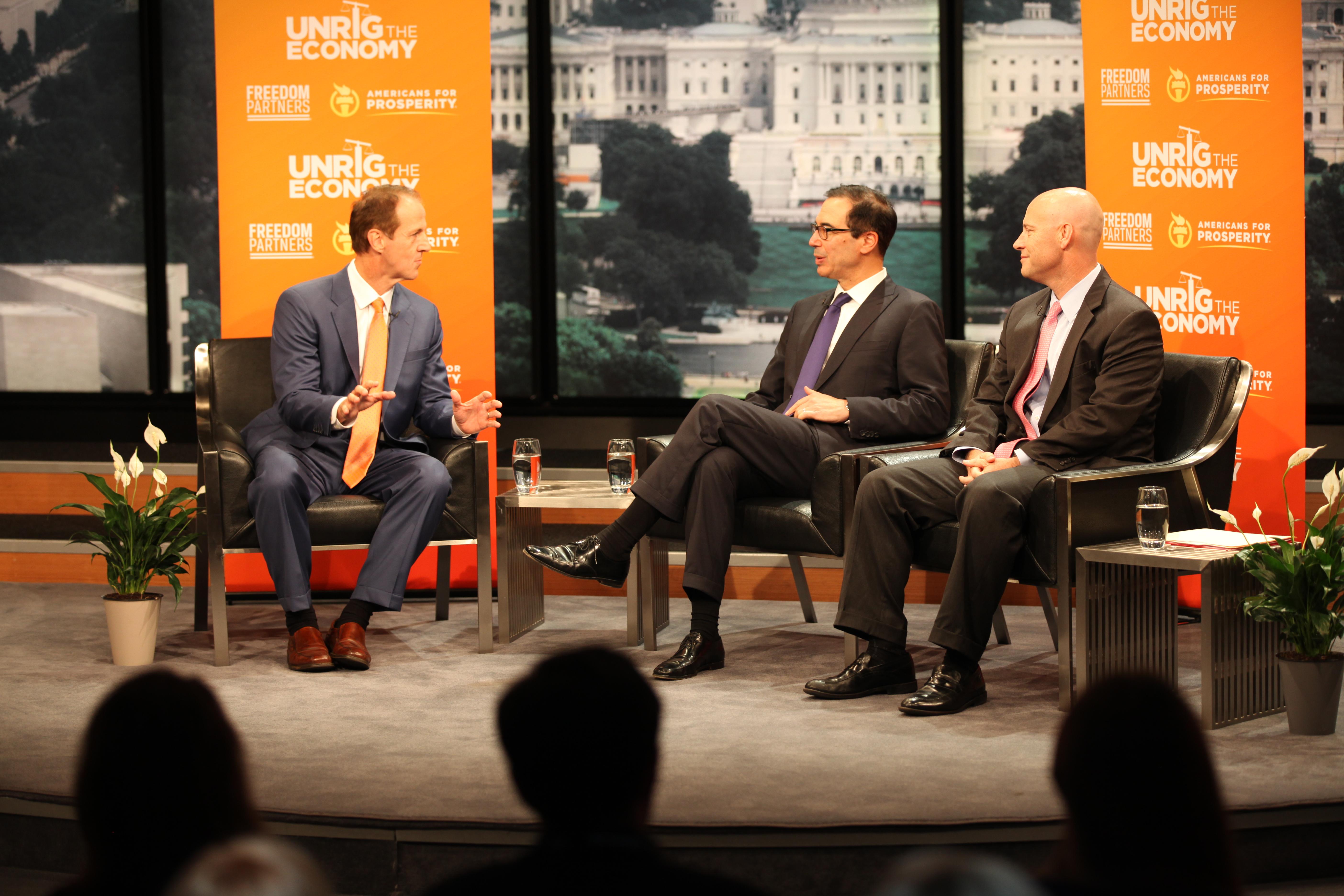 Americans for Prosperity President Tim Philips, Treasury Secretary Steve Mnuchin and White House Legislative Affairs Director Marc Short