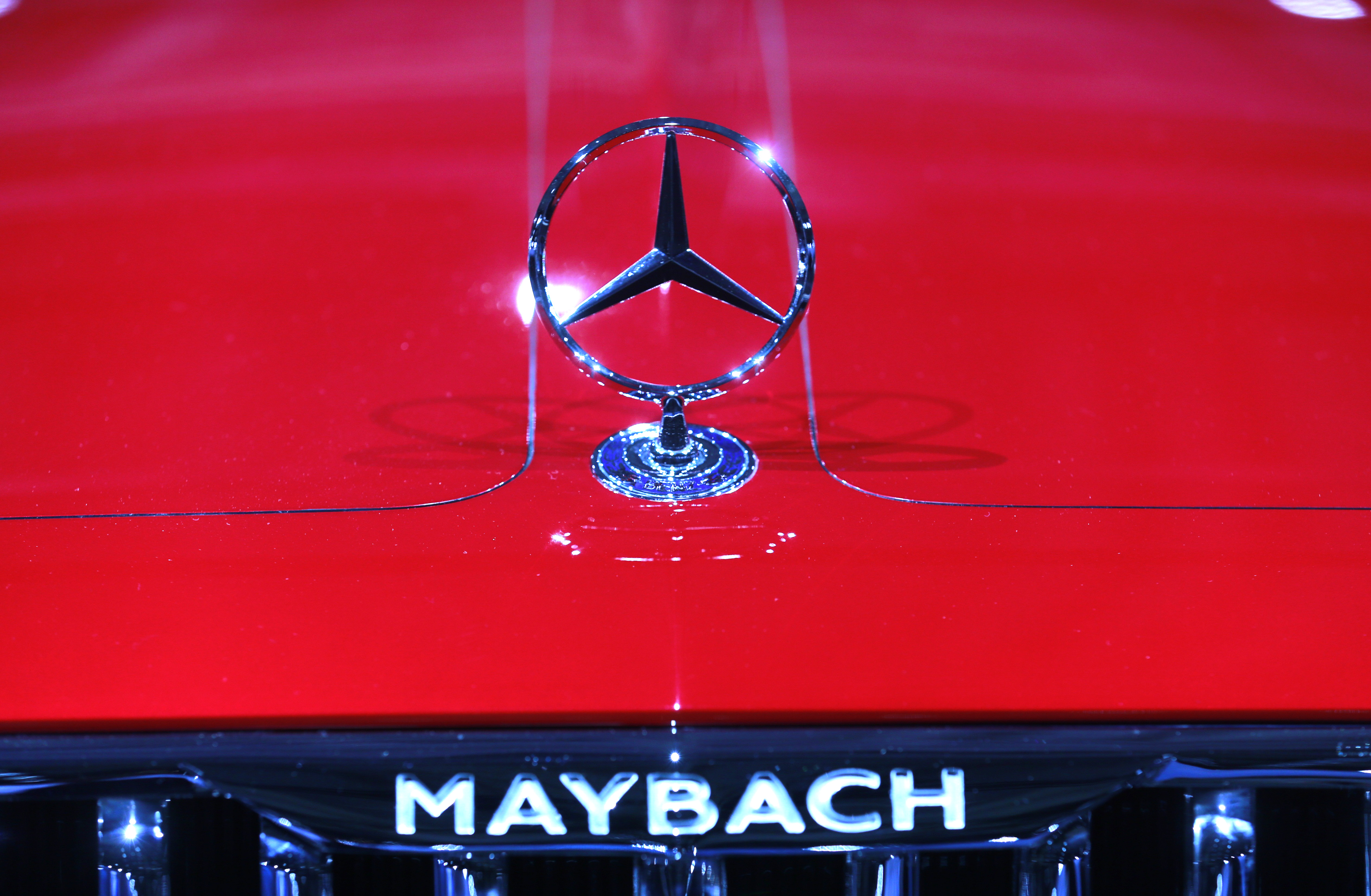 A Mercedes sign is seen on the Mercedes Maybach 6 car before the Daimler annual shareholder meeting in Berlin