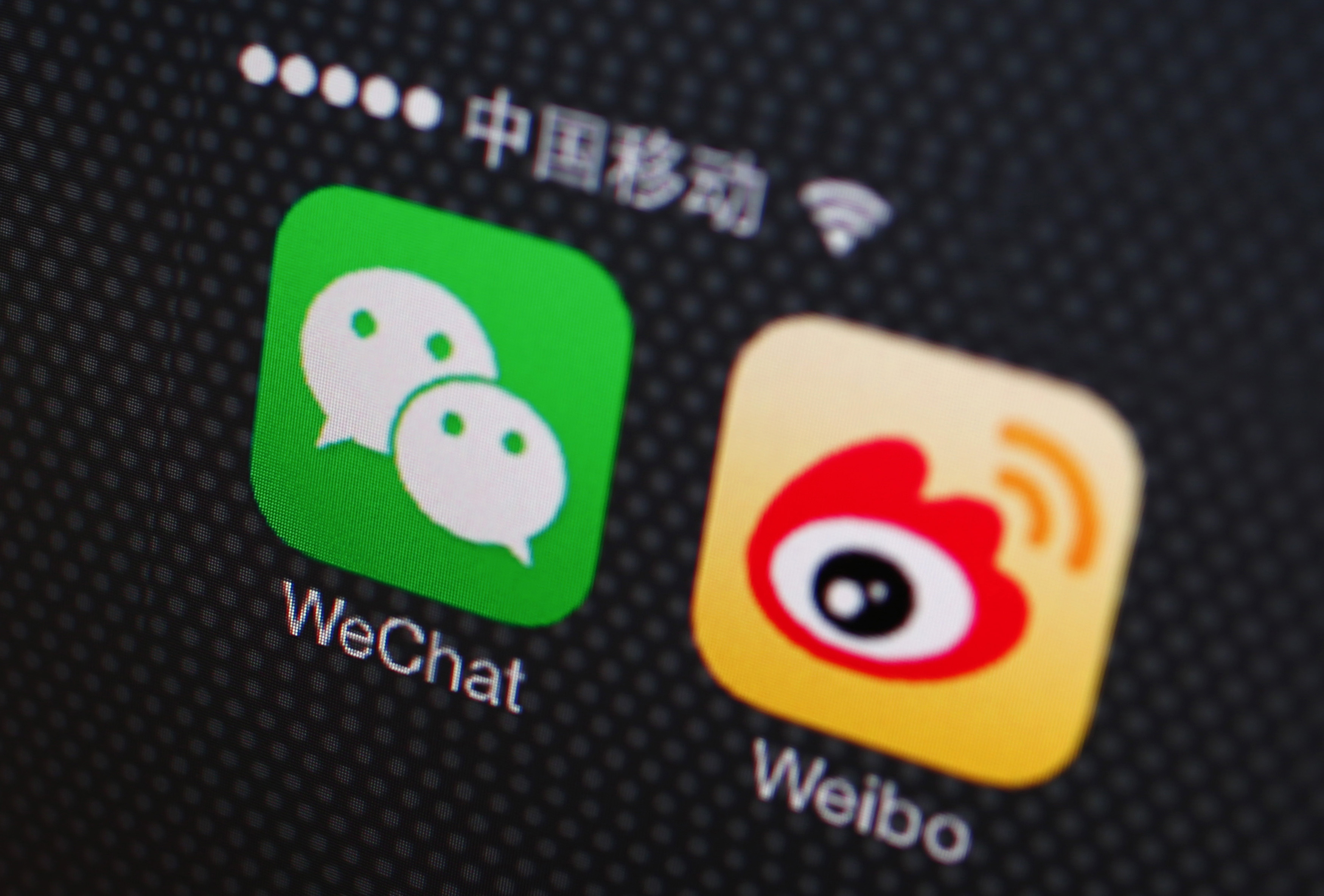 A picture illustration shows icons of WeChat and Weibo app in Beijing