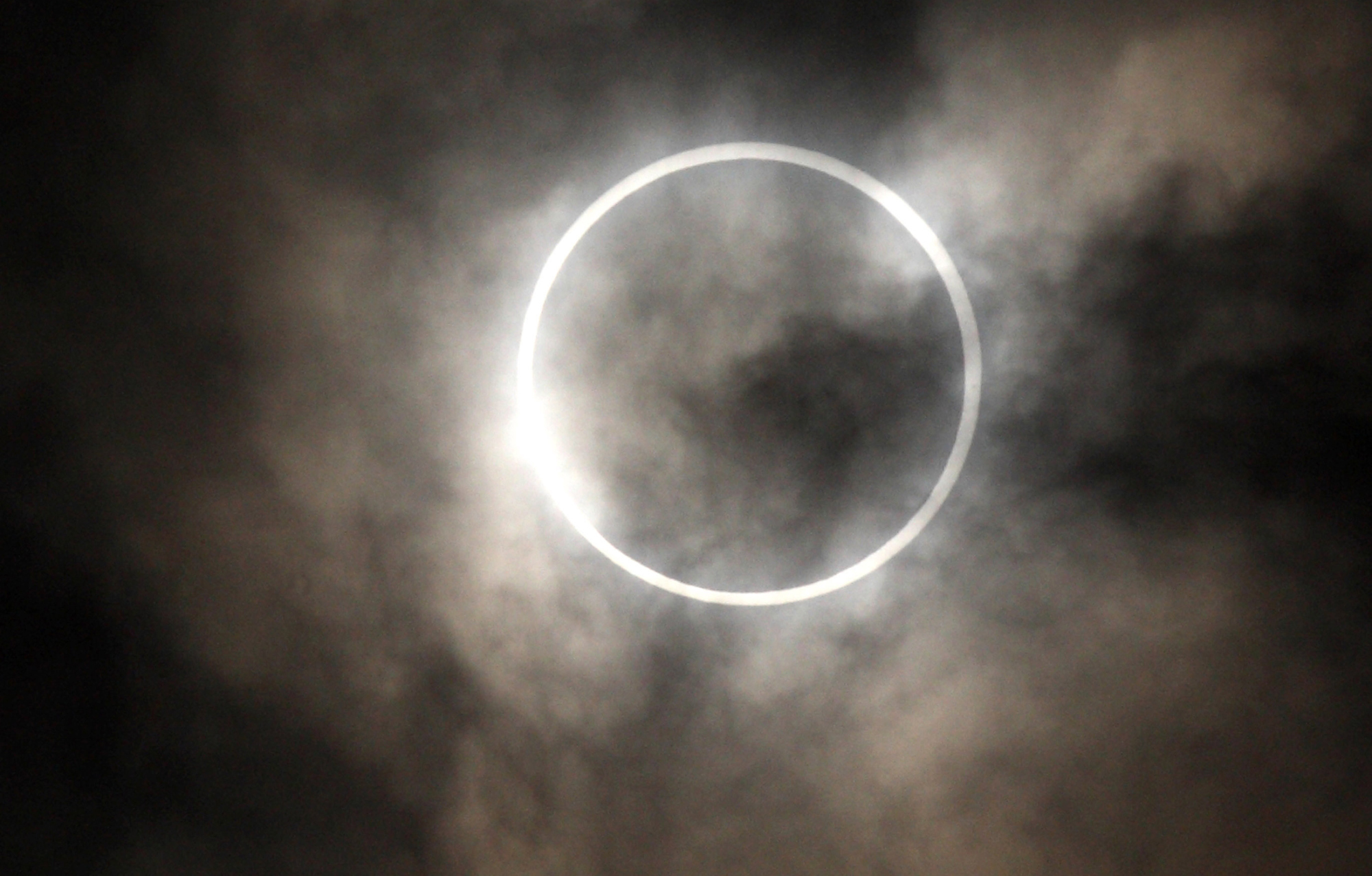 Morning Commuters Observe Solar Eclipse
