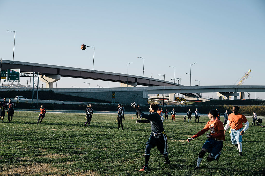 WASHINGTON, DC - NOV 23 Players take the field on the Capitol Alumni Network flag football league at Anacostia Park near the 11th Street Bridge on Dec. 05, 2015. (Photo by Greg Kahn/GRAIN for The Washington Post)