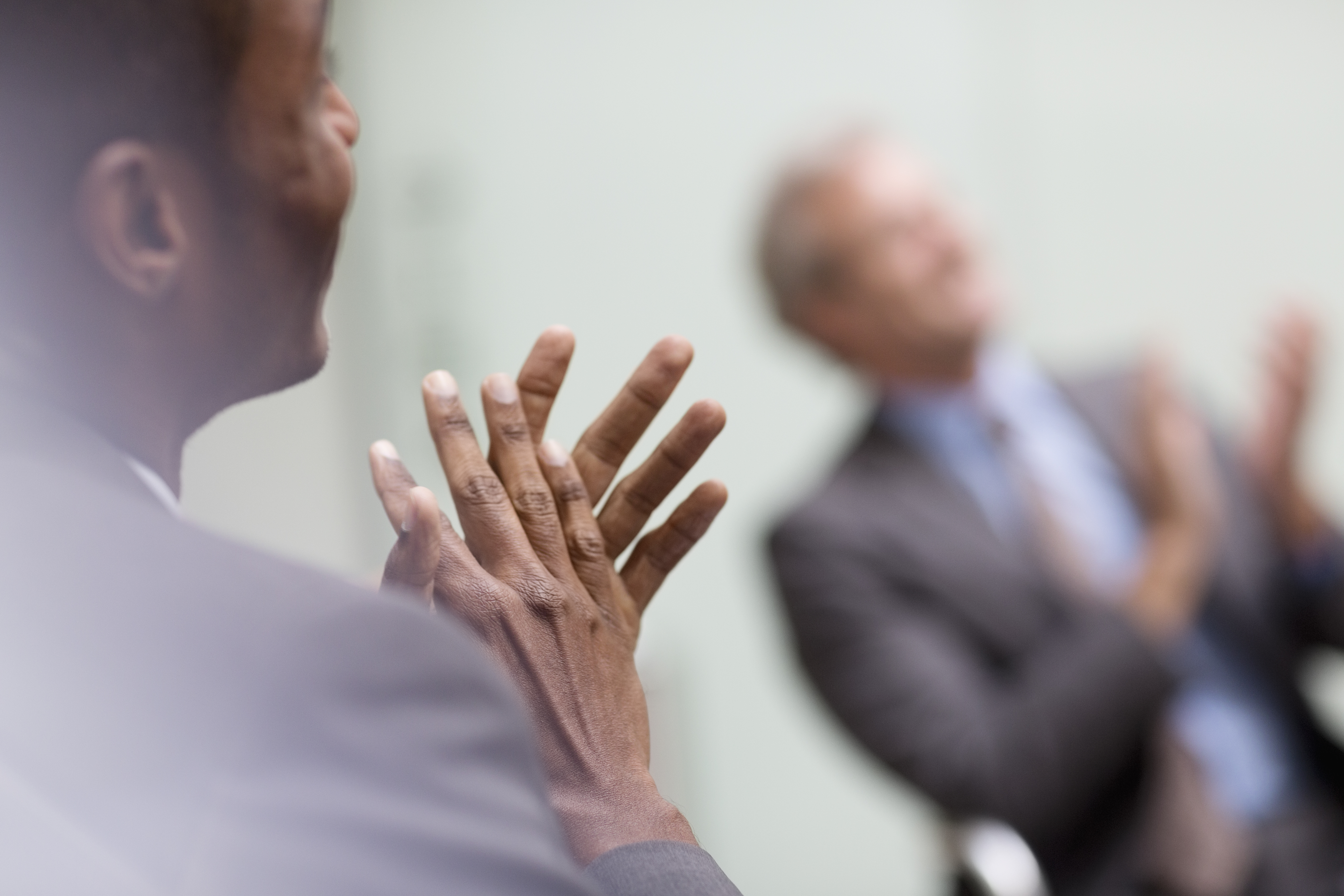 Businessmen clapping in meeting