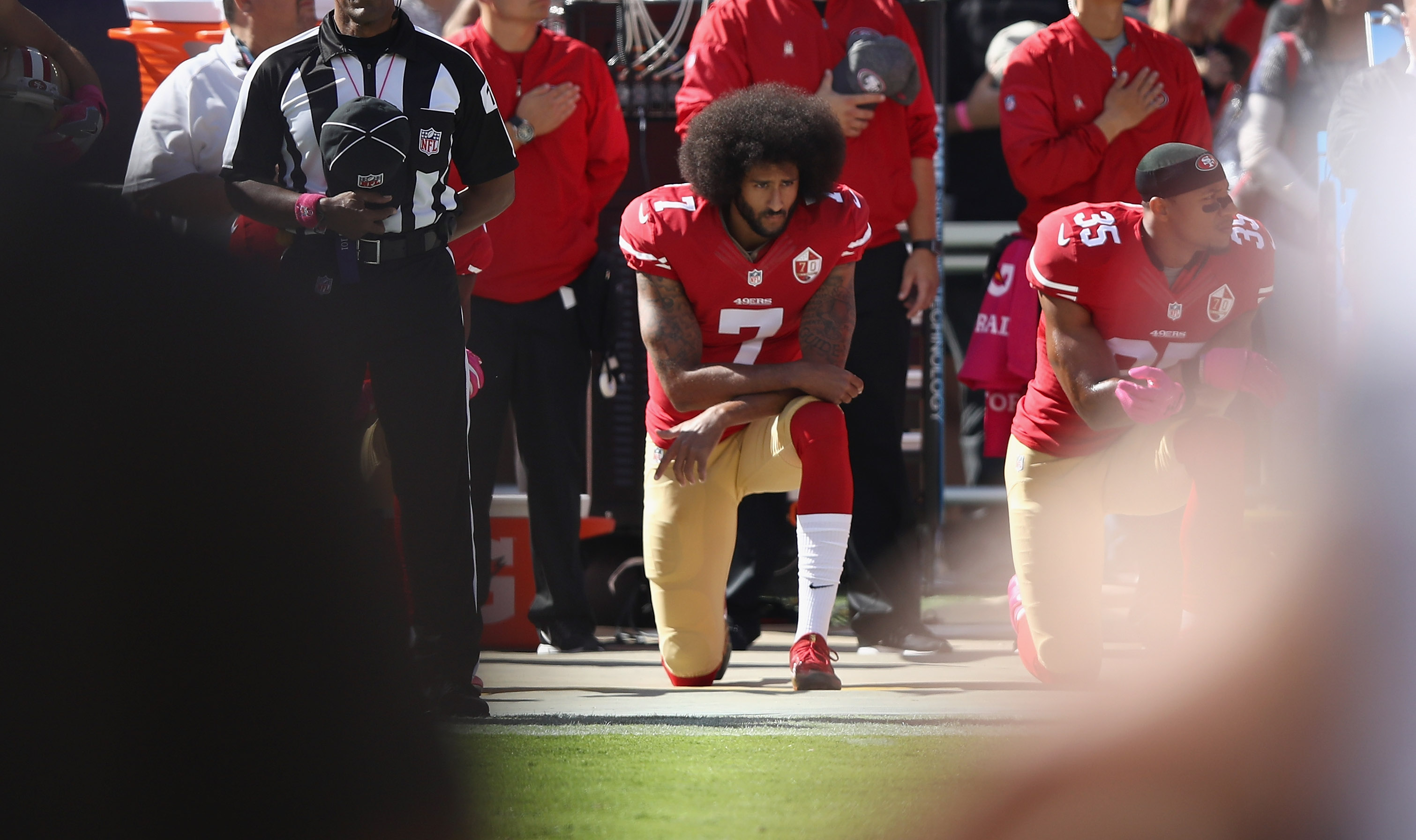 Colin Kaepernick of the San Francisco 49ers kneels for the National Anthem before their game against the Tampa Bay Buccaneers at Levi's Stadium on October 23, 2016 in Santa Clara, California.