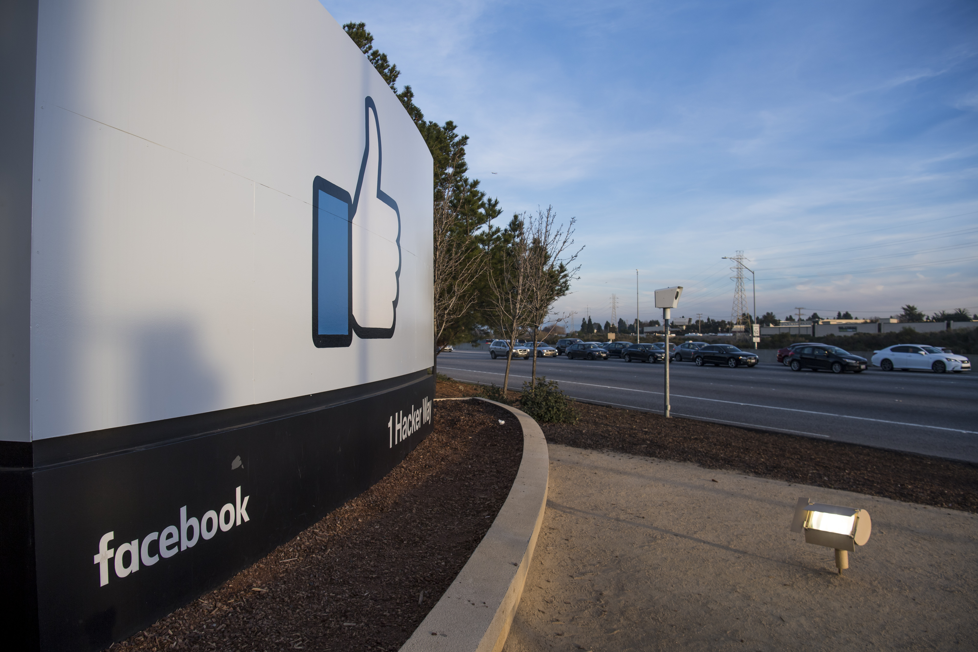 Signage is displayed outside Facebook Inc. headquarters in Menlo Park, California, U.S., on Monday, Jan. 30, 2017.