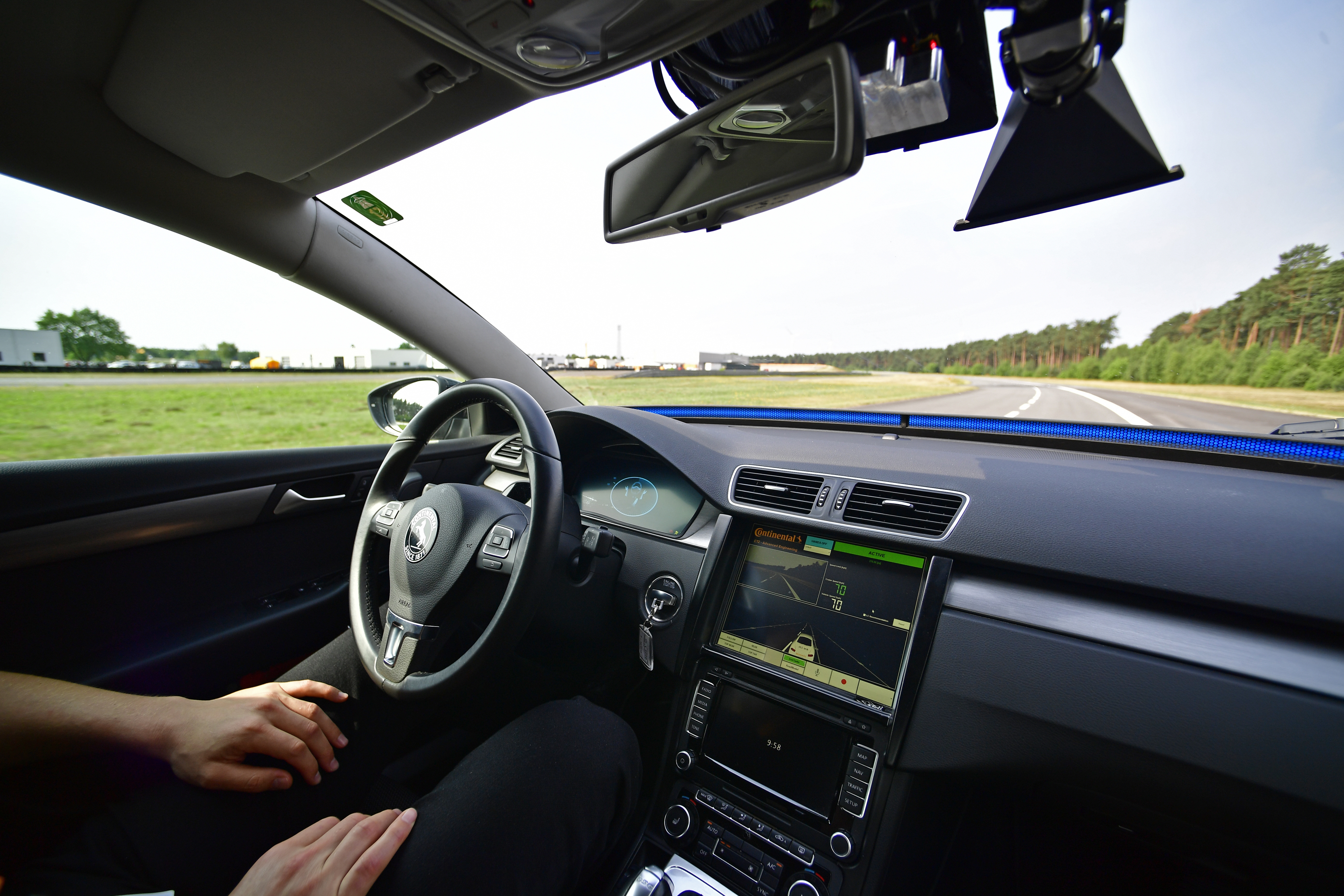 A driver presents a Cruising Chauffeur, a hands free self-driving system designed for motorways during a media event by Continental to showcase new automotive technologies on June 20, 2017 in Hanover, Germany.
