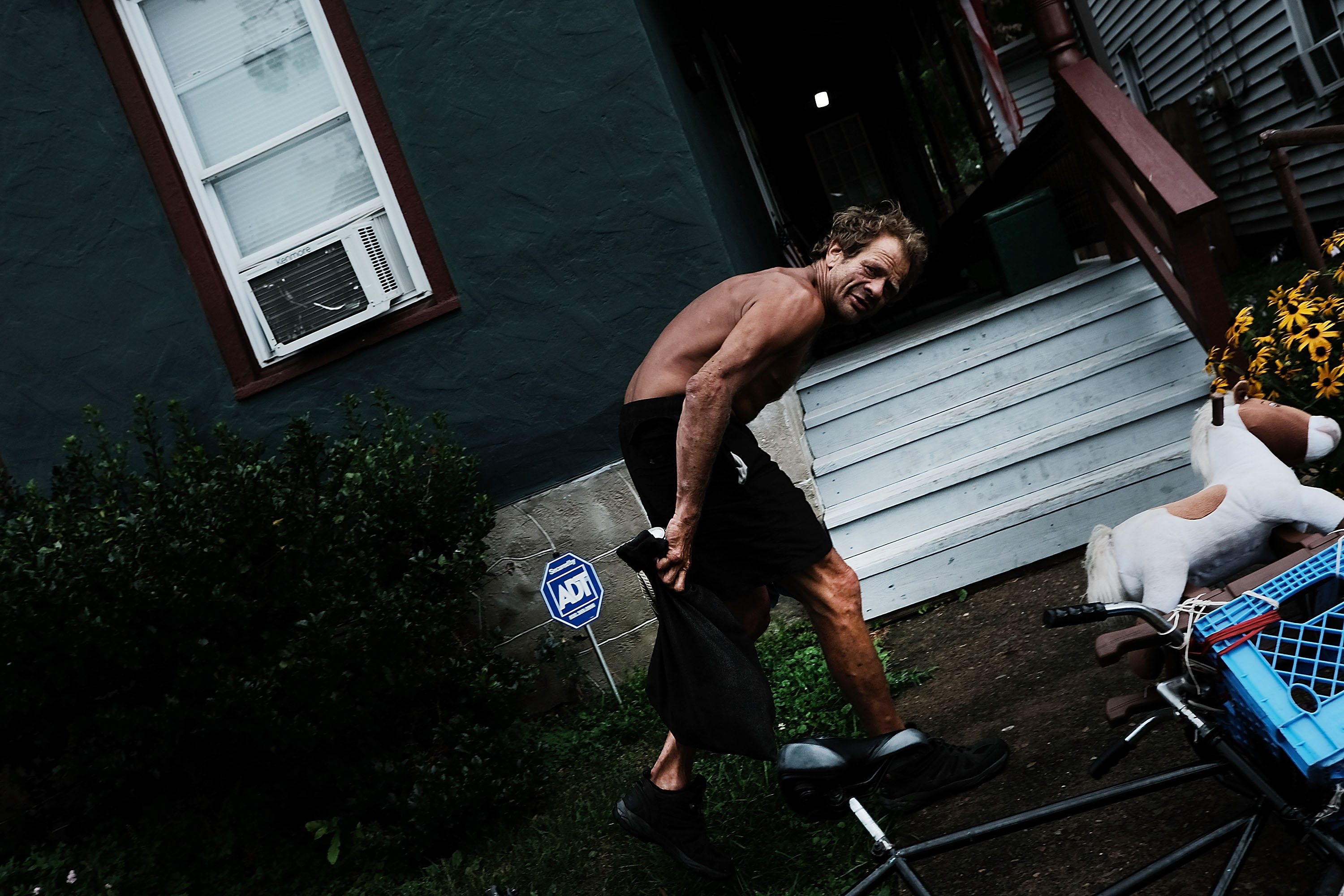 A man walks through the struggling city of Williamsport, which has recently seen an epidemic of opioid use among its population on July 13, 2017 in Williamsport, Pennsylvania.