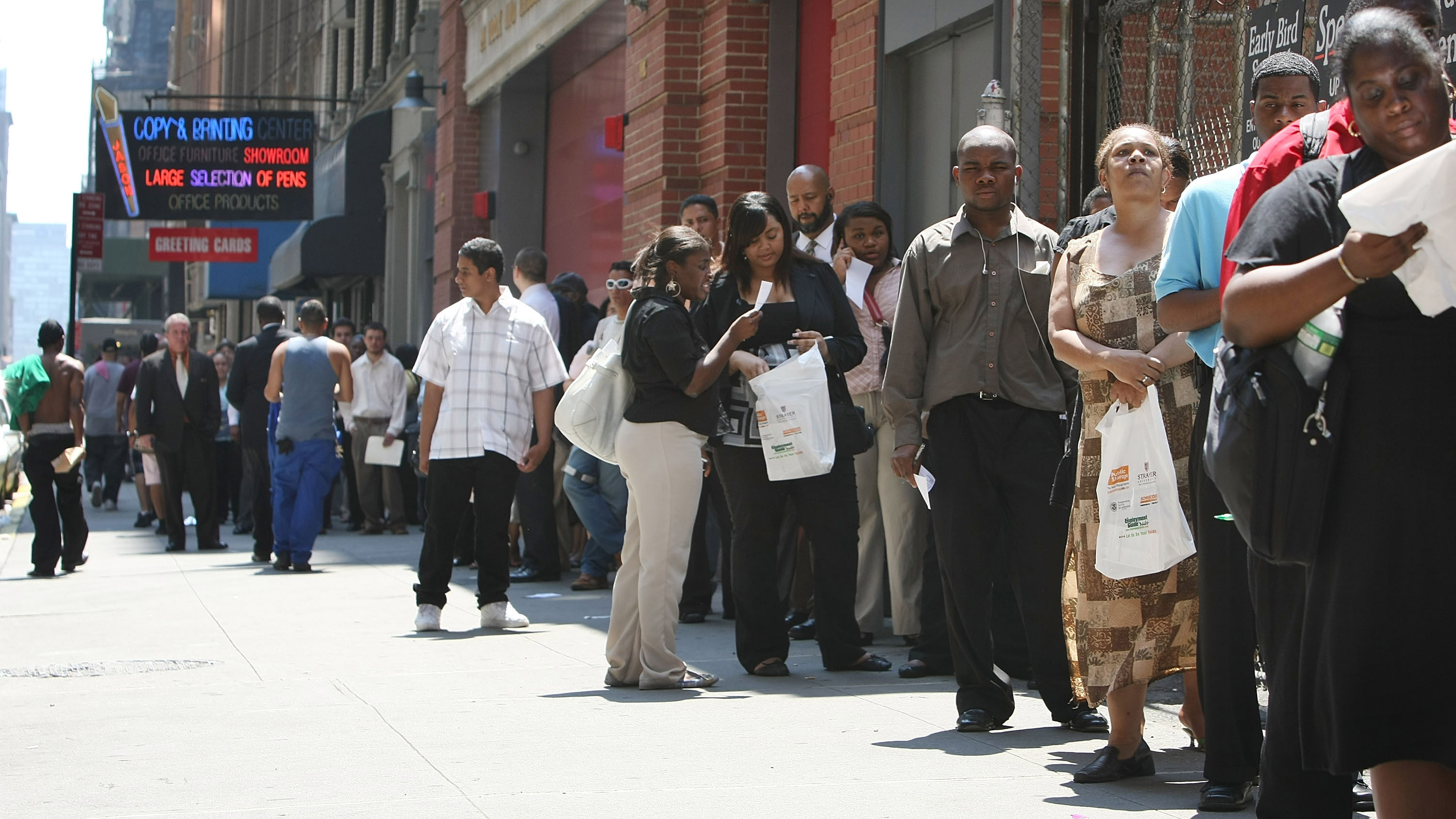 People wait in line to enter the Diversity Job Fair at the Affinia Hotel June 10, 2008 in New York City.