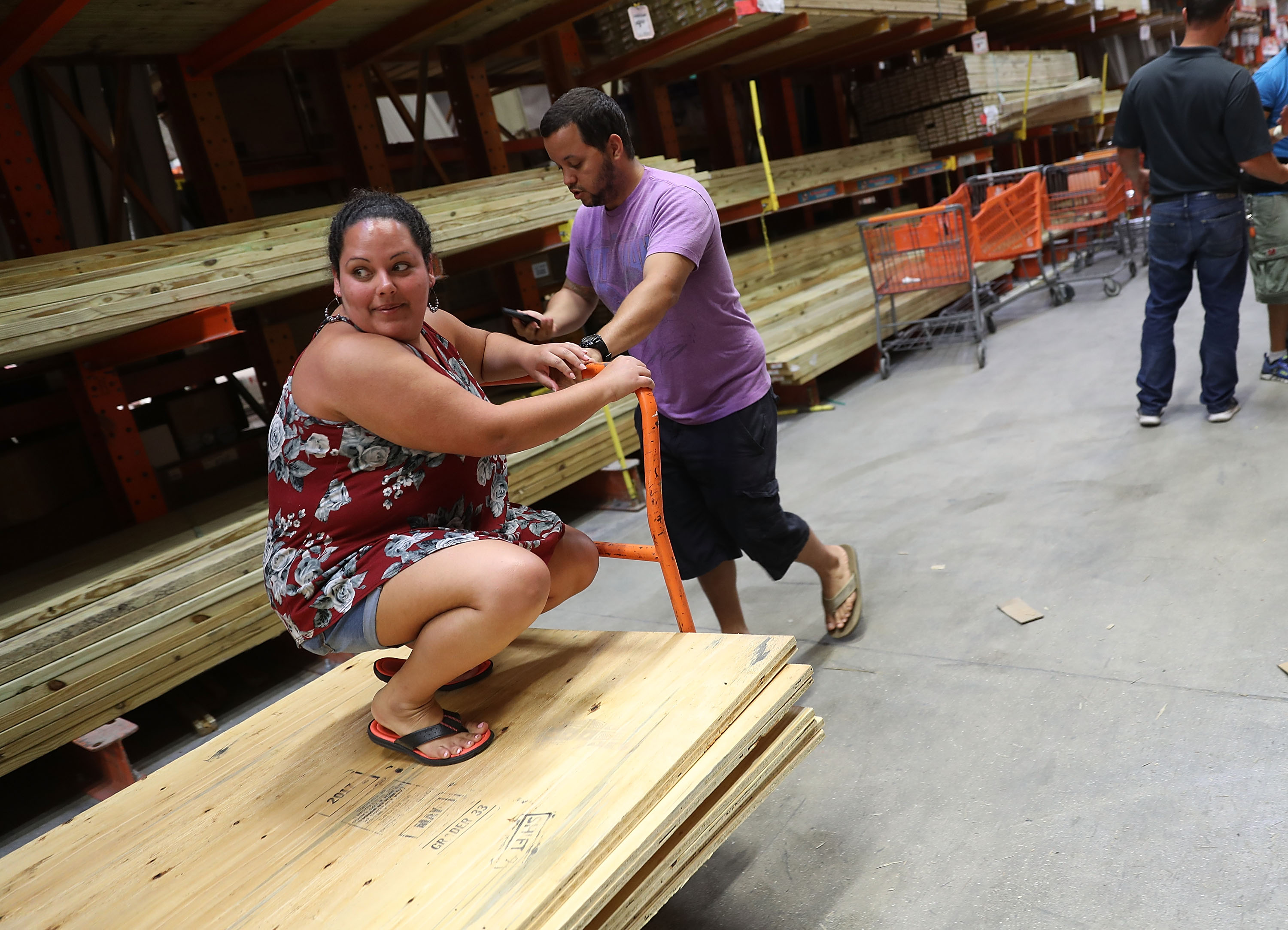 People purchase plywood at The Home Depot as they prepare for Hurricane Irma on September 6, 2017 in Miami, Florida.
