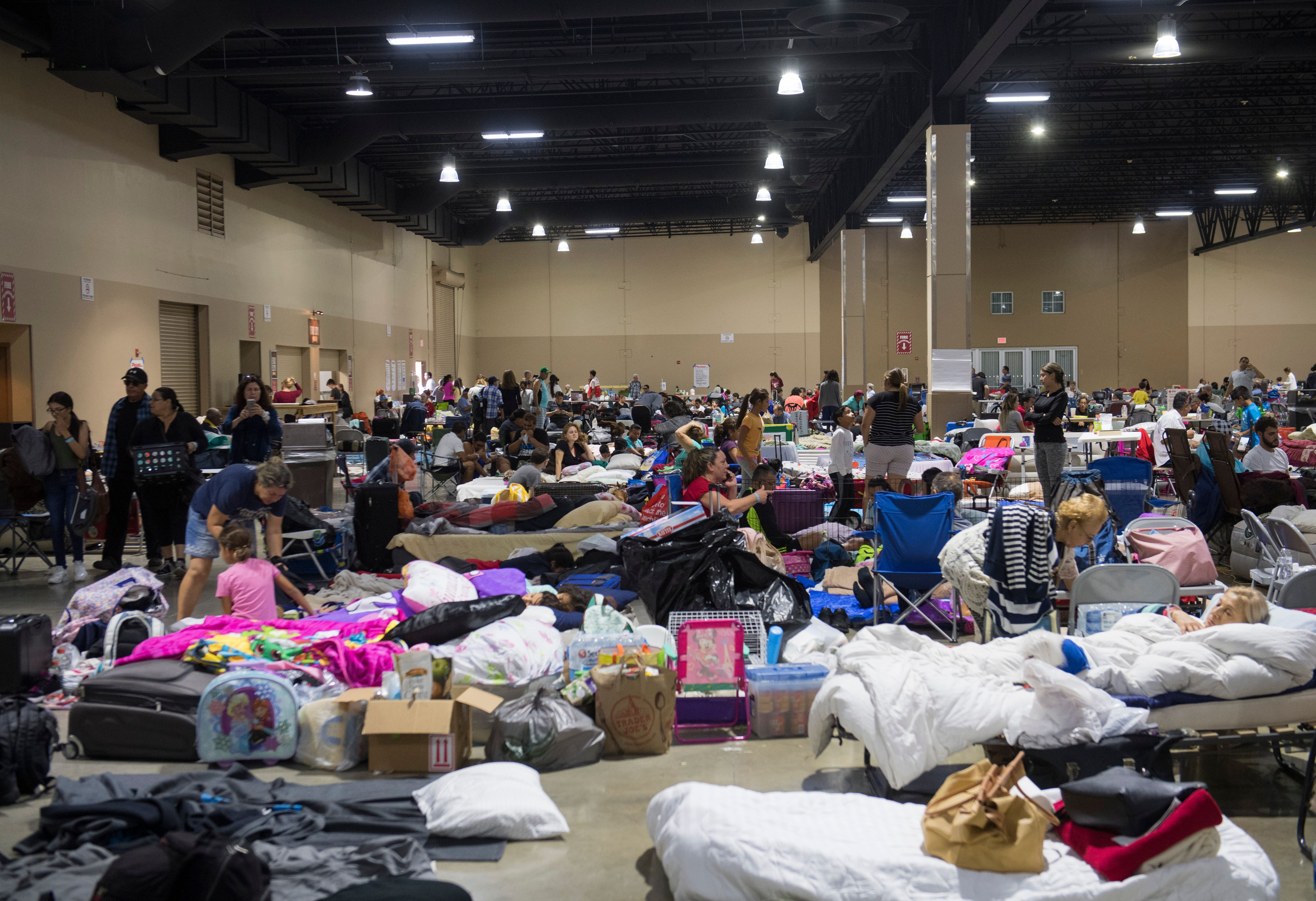 Hundreds of people gather in an emergency shelter at the Miami-Dade County Fair Expo Center in Miami, Florida, September 8, 2017, ahead of Hurricane Irma.
