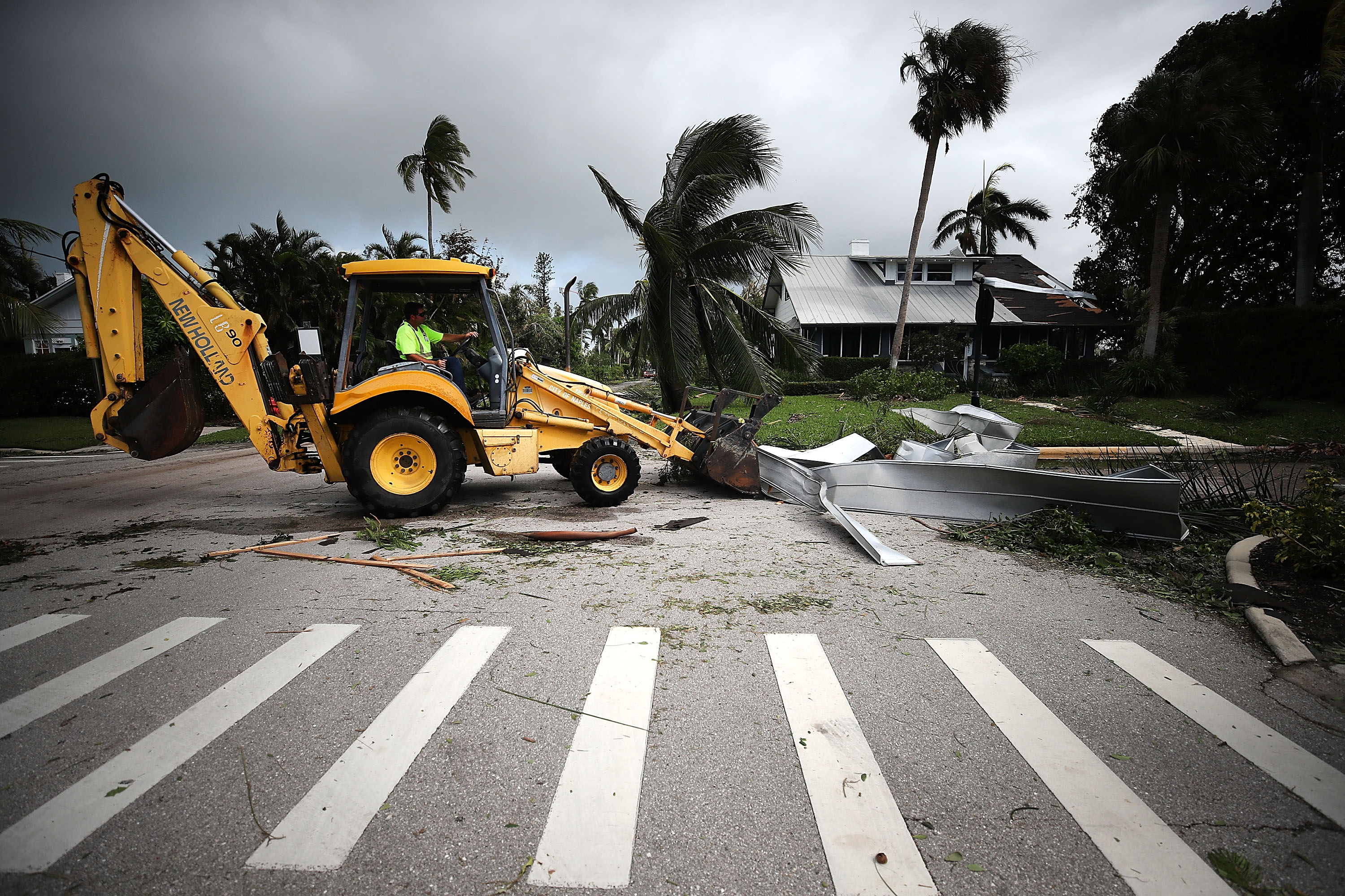 Road crews clear debris after Hurricane Irma passed through on September 11, 2017 in Naples, Florida.