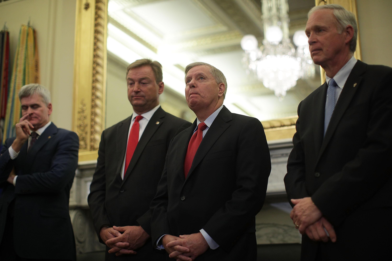 U.S. Sen. Bill Cassidy (R-LA), Sen. Dean Heller (R-NV), Sen. Lindsey Graham (R-SC) and Sen. Ron Johnson (R-WI) attend a news conference on health care September 13, 2017 on Capitol Hill in Washington, DC.