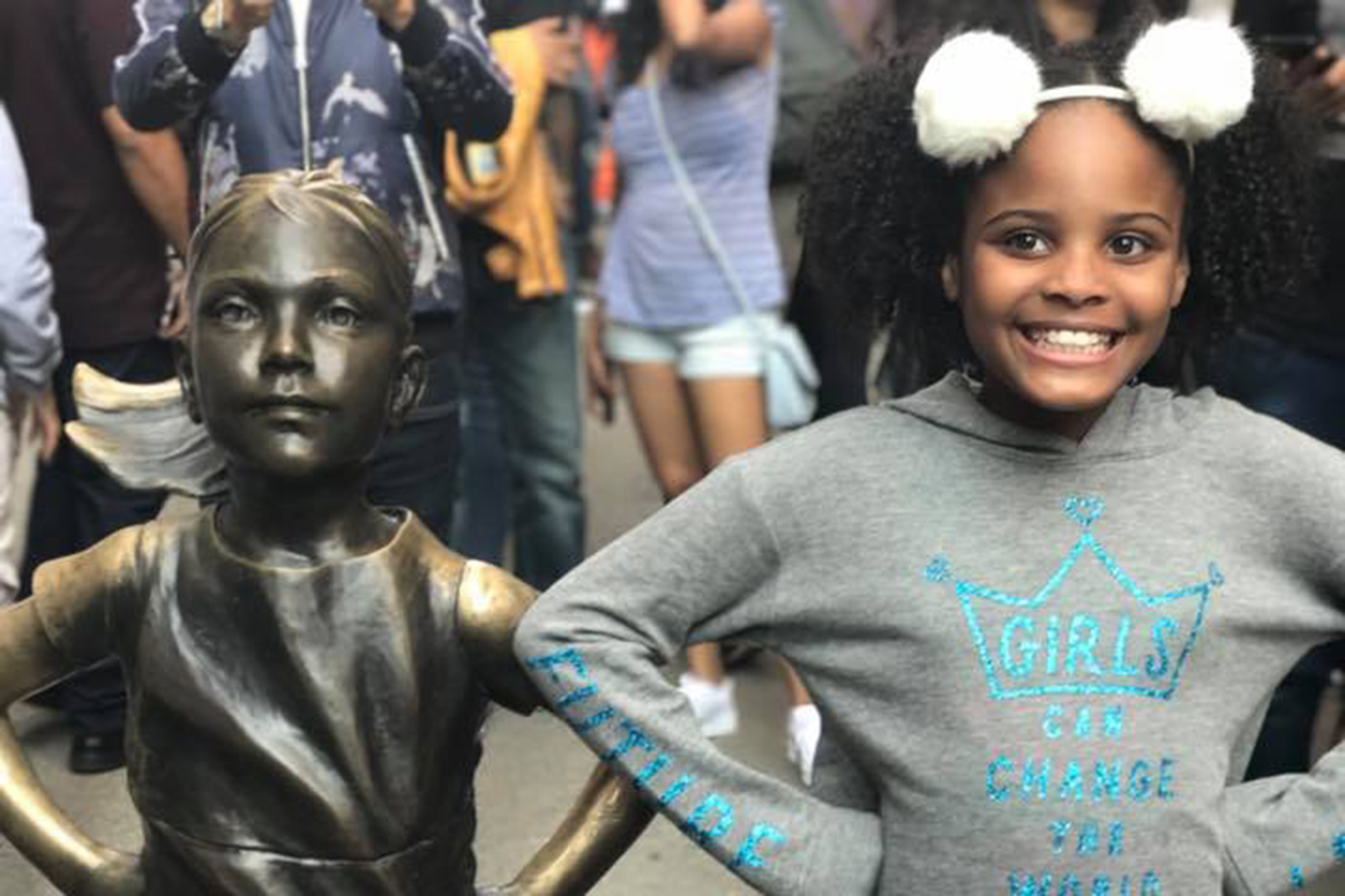 Mari Copeny, Little Miss Flint, poses next to the Fearless Girl statue on Wall Street in lower Manhattan, New York City, New York.