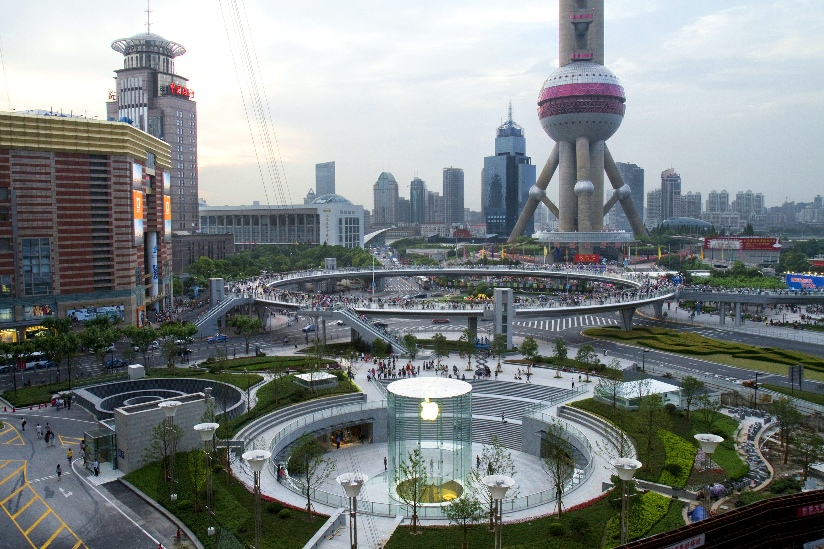 Apple's new flagship store stands in front of the Oriental Pearl Tower in Shanghai.