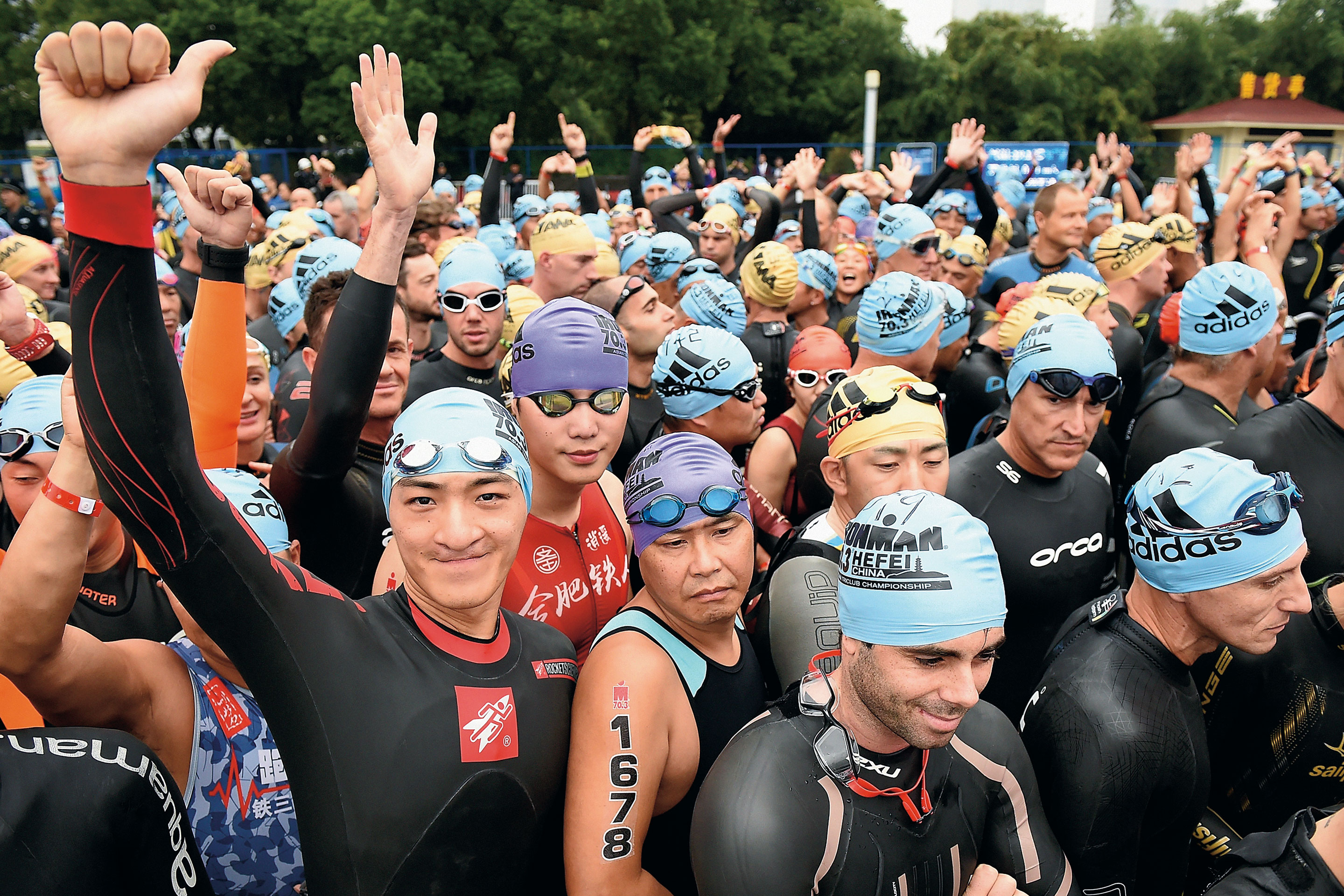 THE NEW IRONMEN: Competitors prepare for the swim phase of a triathlon event in Hefei, China. The number of Chinese nationals competing in Ironman events rose sevenfold in 2016.