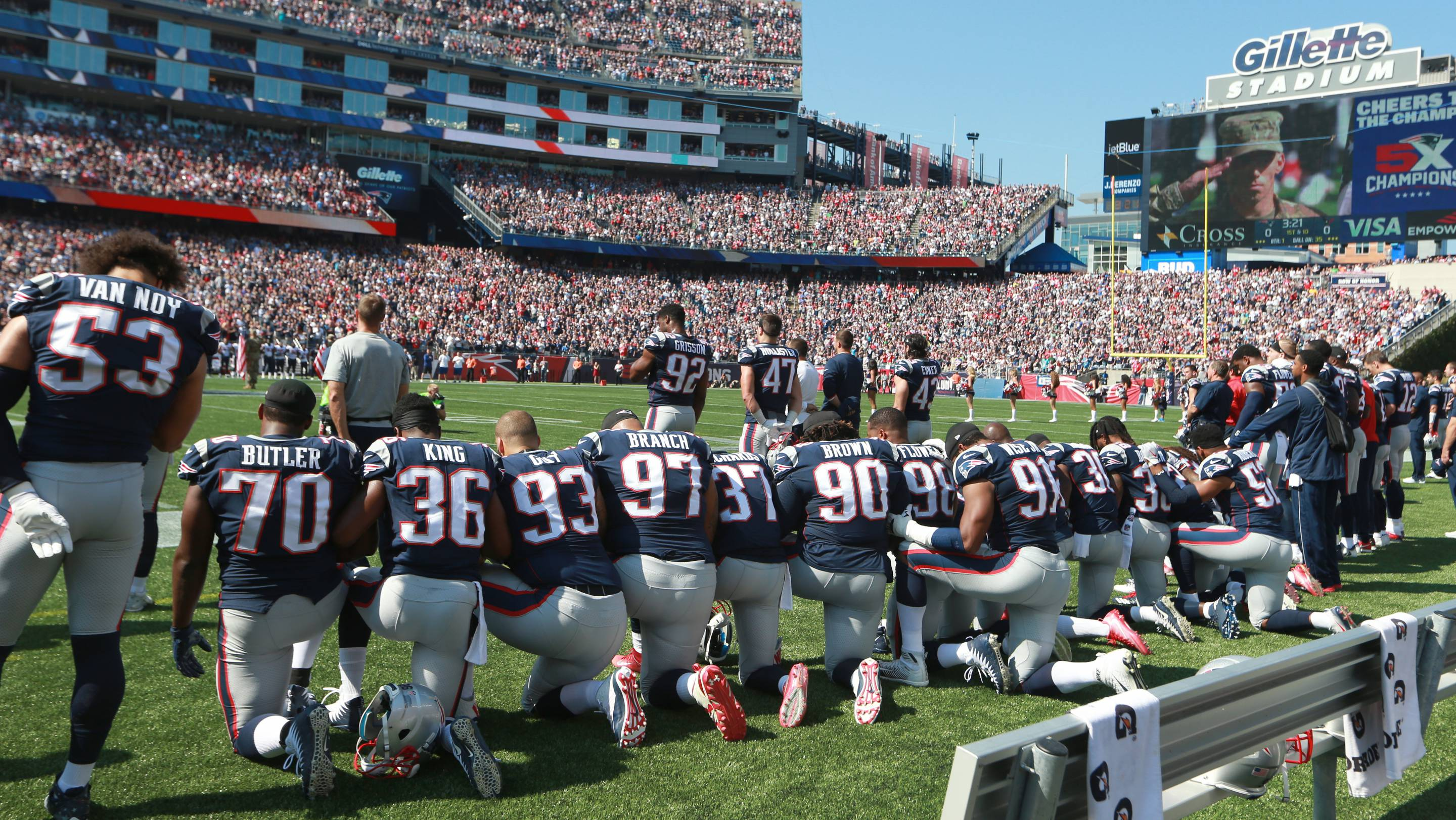 New England Patriots players take a knee during the national anthem before the start of a game against the Houston Texans at Gillette Stadium in Foxborough, Mass., Sept. 24, 2017.