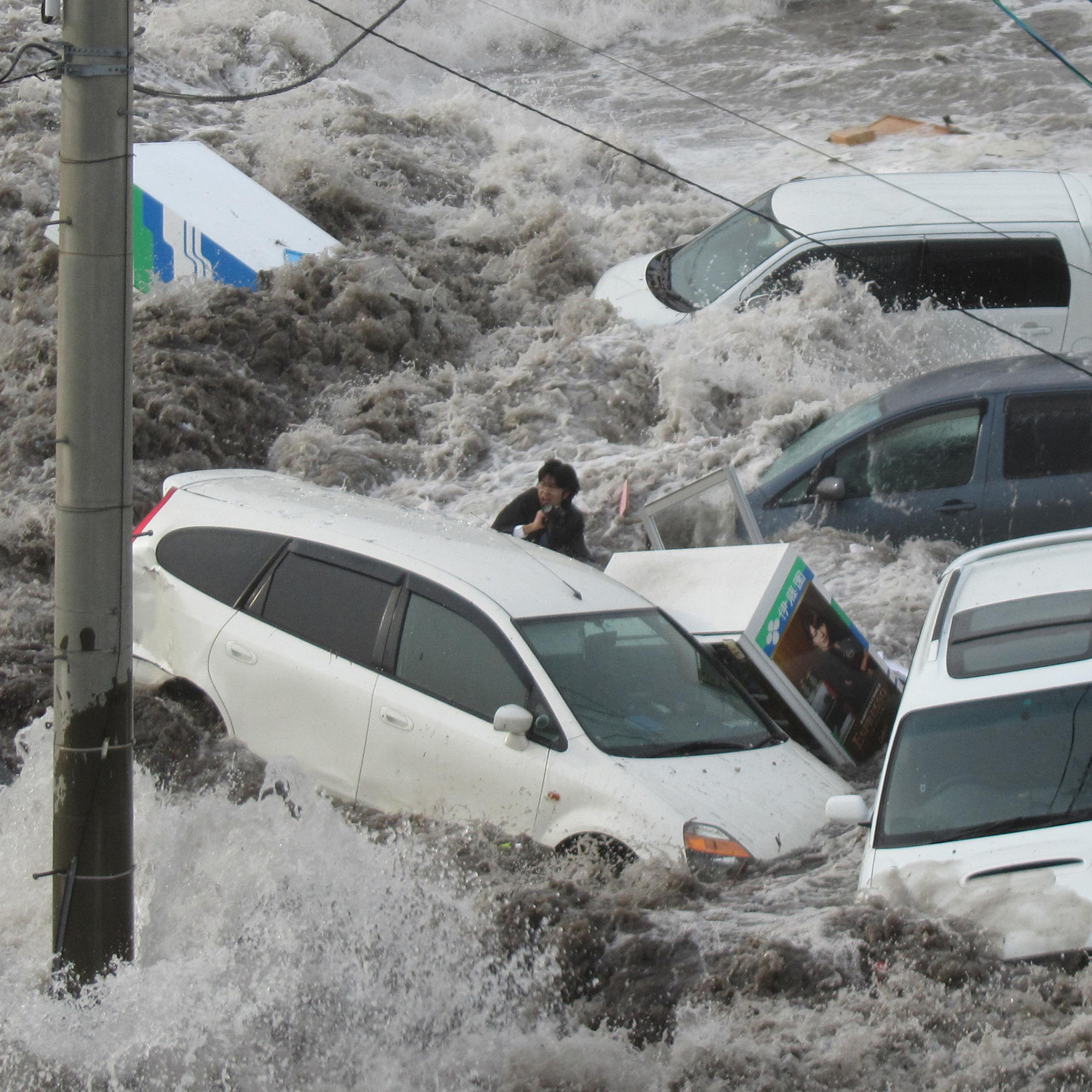 Toya Chiba, a reporter for local newspaper Iwate Tokai Shimbun, is swept by a tsunami at Kamaishi port