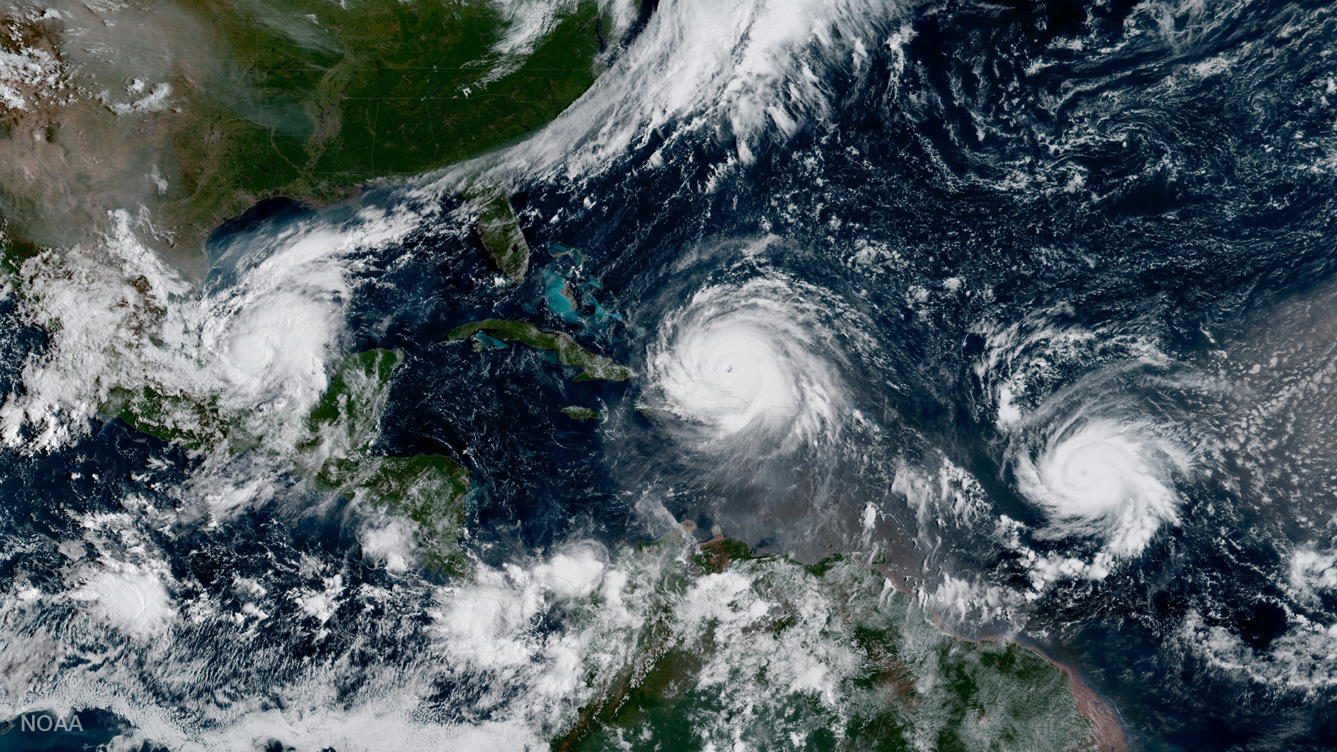 Hurricane Irma, Hurricane Jose and Hurricane Katia are pictured  in the Atlantic Ocean in this  NOAA satellite handout photo