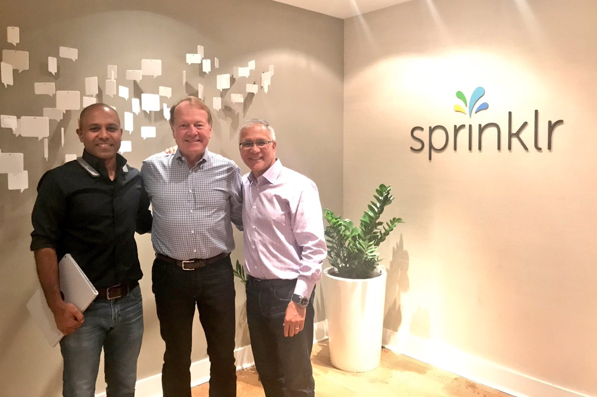 New Sprinklr board member John Chambers flanked by CEO Ragy Thomas (right) and President Carlos Dominguez