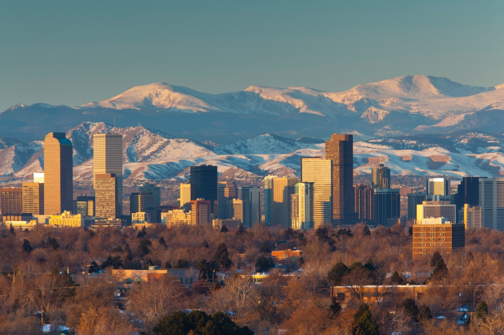 USA, Colorado, Denver, City view and Rocky Mountains from east