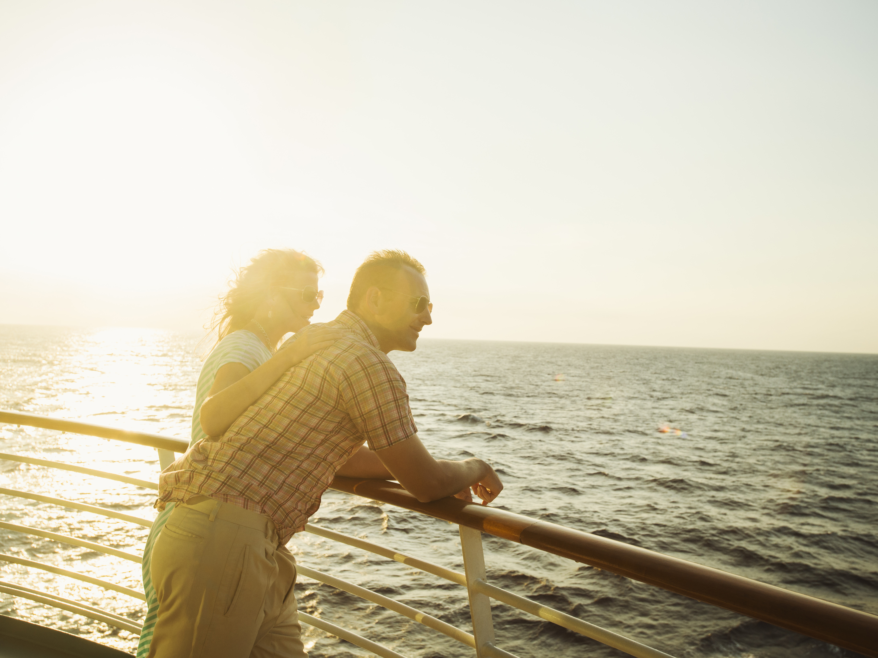 Caucasian couple admiring view from boat deck