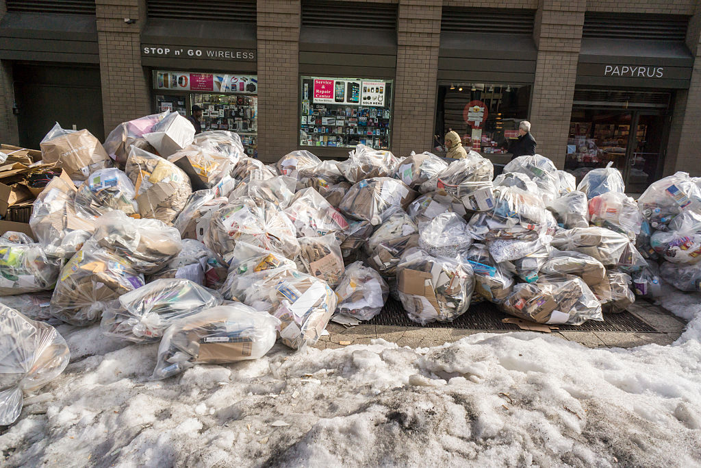 Trash accumulates and awaits pick-up in New York