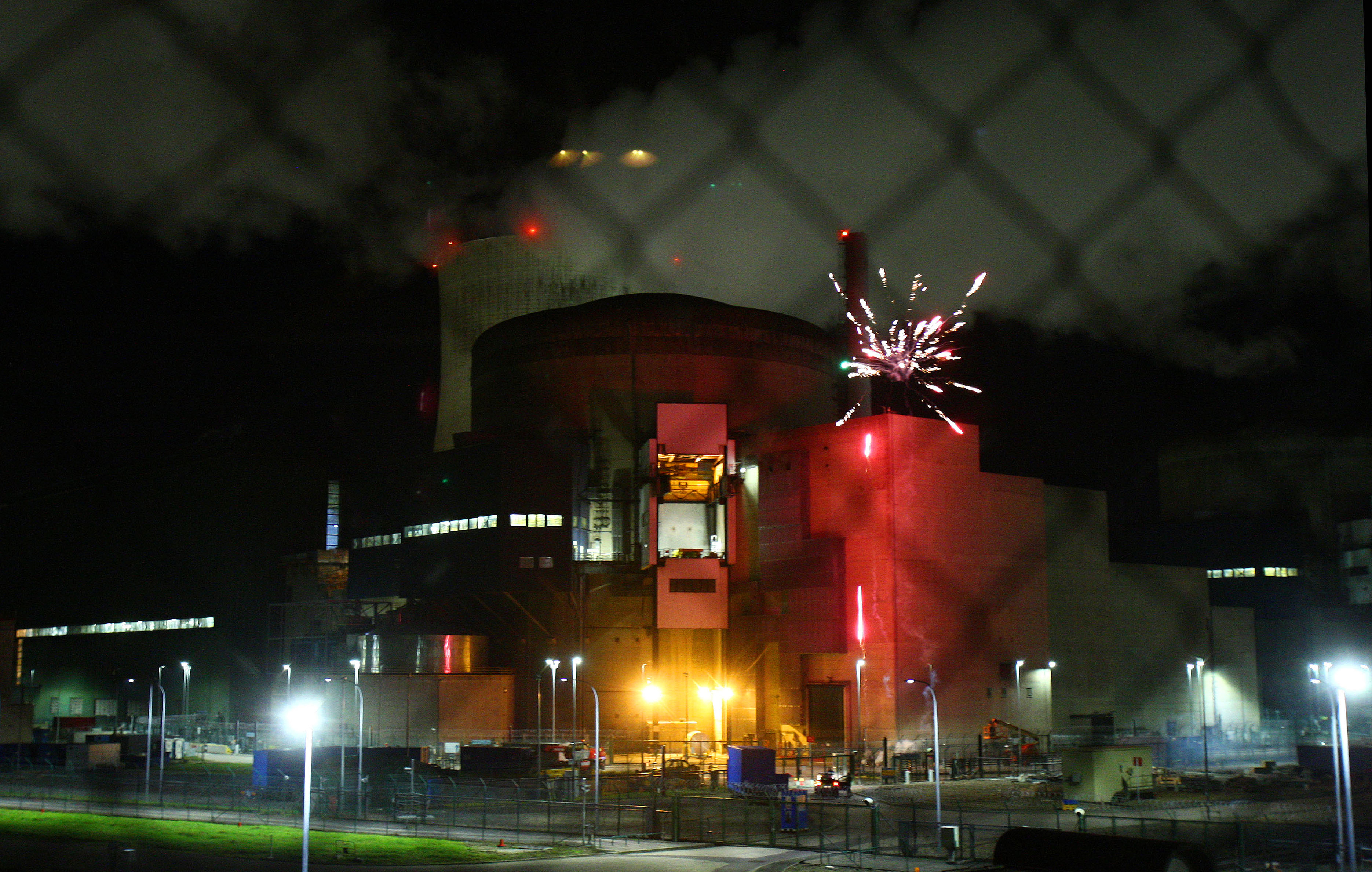 A firework detonates inside the grounds of Cattenom nuclear power station in eastern France, let off by protesters to show its vulnerability to attack by terrorists.