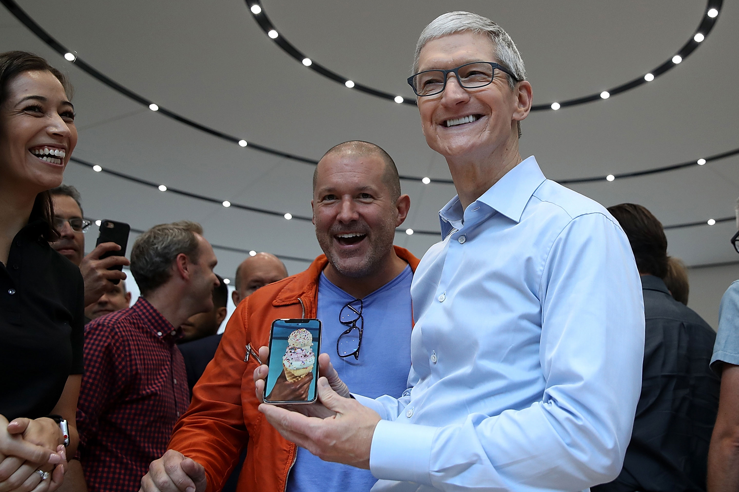Apple CEO Tim Cook (R) and Apple chief design officer Jony Ive (L) look at the new Apple iPhone X during its debut at the Steve Jobs Theatre on the Apple Park campus on September 12, 2017 in Cupertino, California.