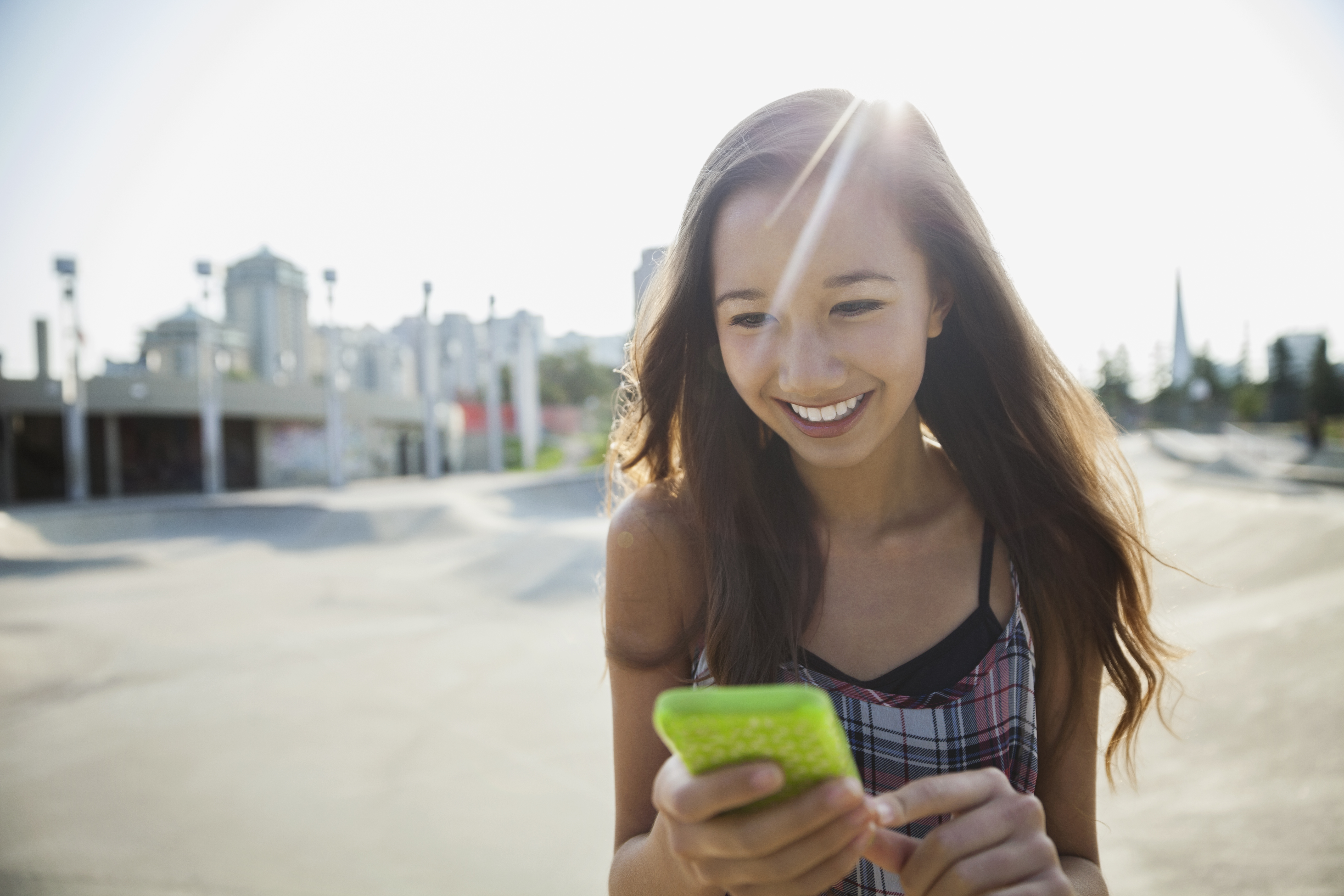 Smiling teenage girl with cell phone