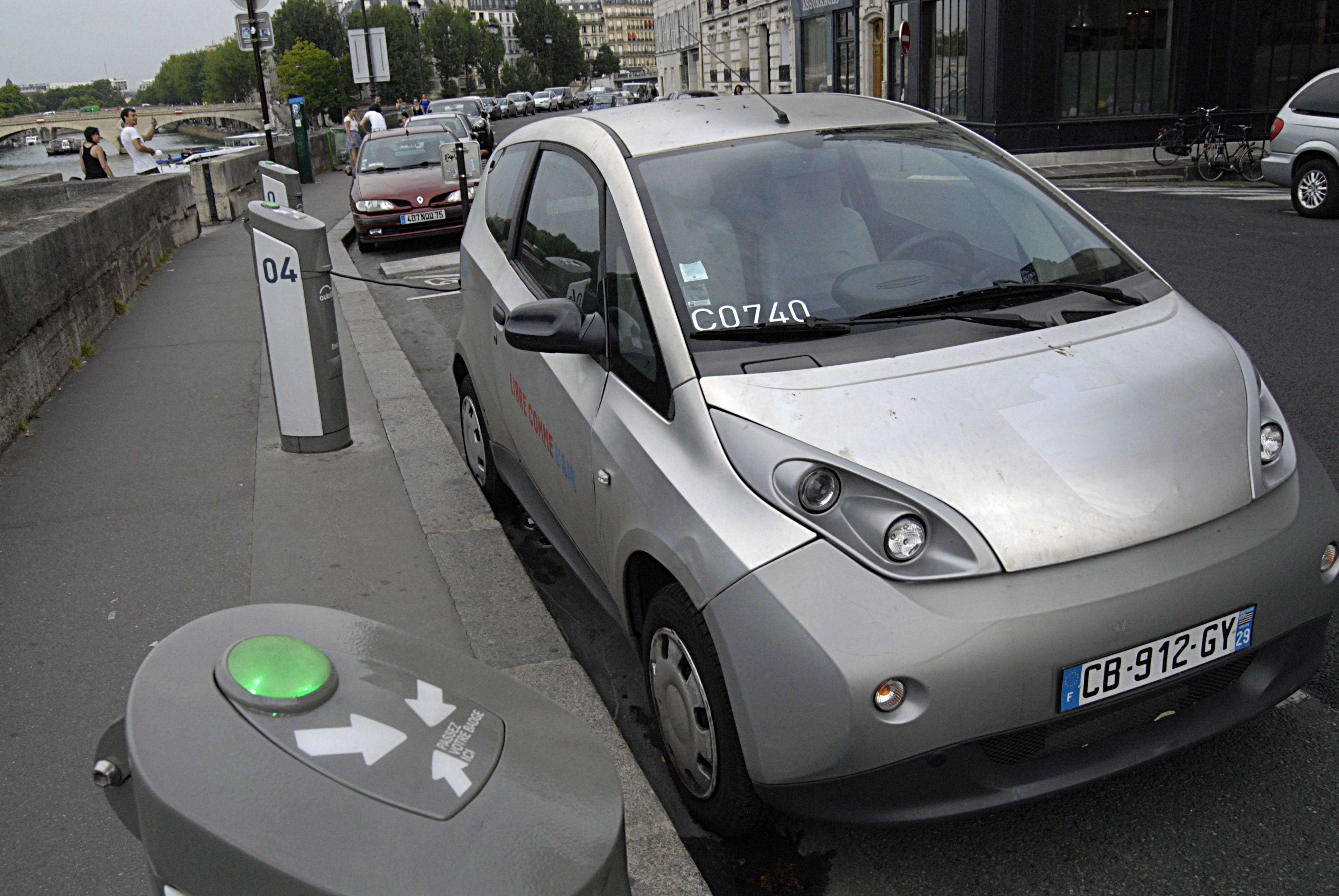 Hybrid car parked at recharge station at autolib
