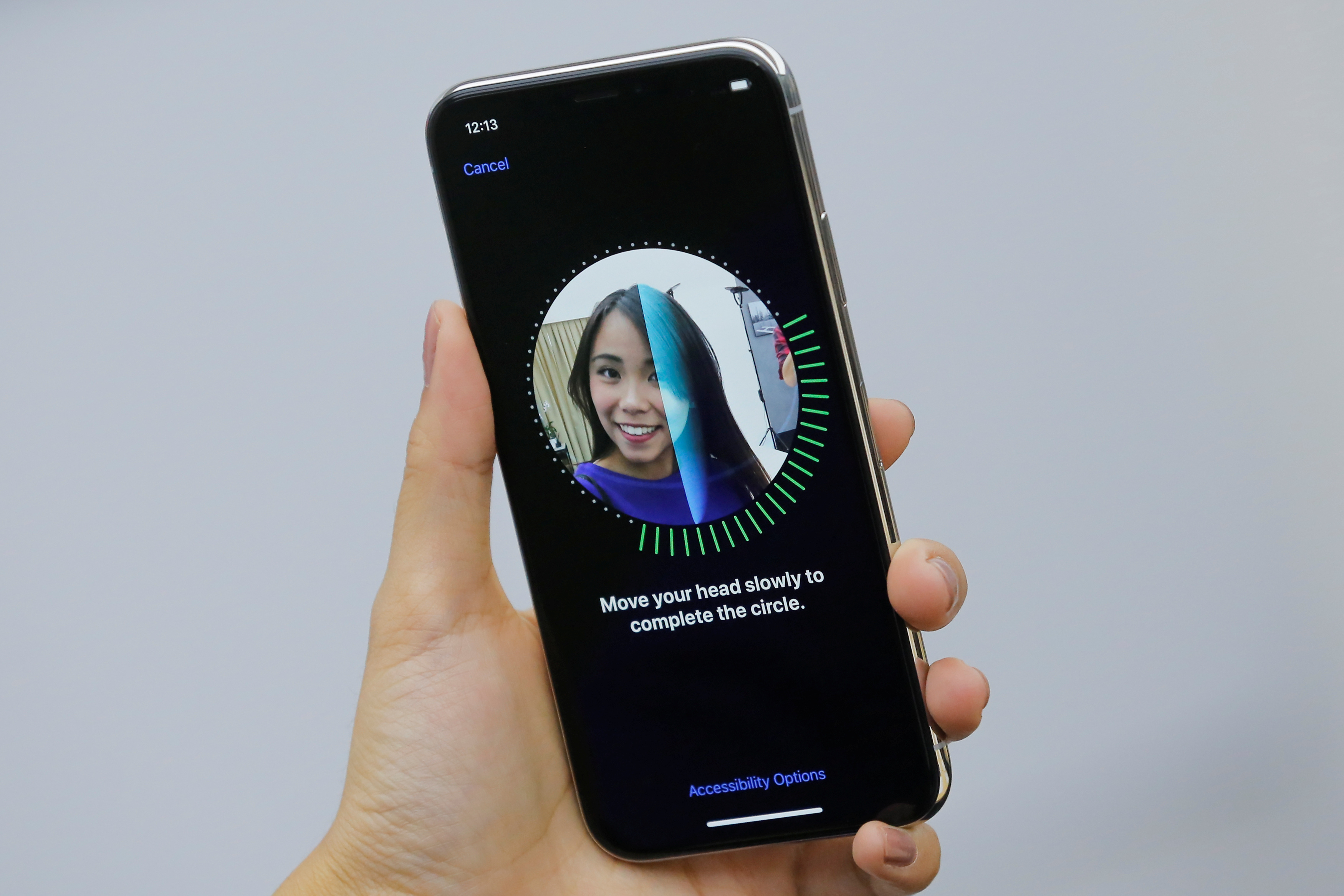 An attendee uses the Face ID function on the new iPhone X during a presentation for the media in Beijing