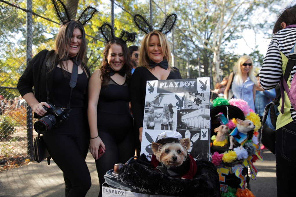 A dog dressed as Hugh Hefner takes part in the annual halloween dog parade at Manhattan's Tompkins Square Park in New York