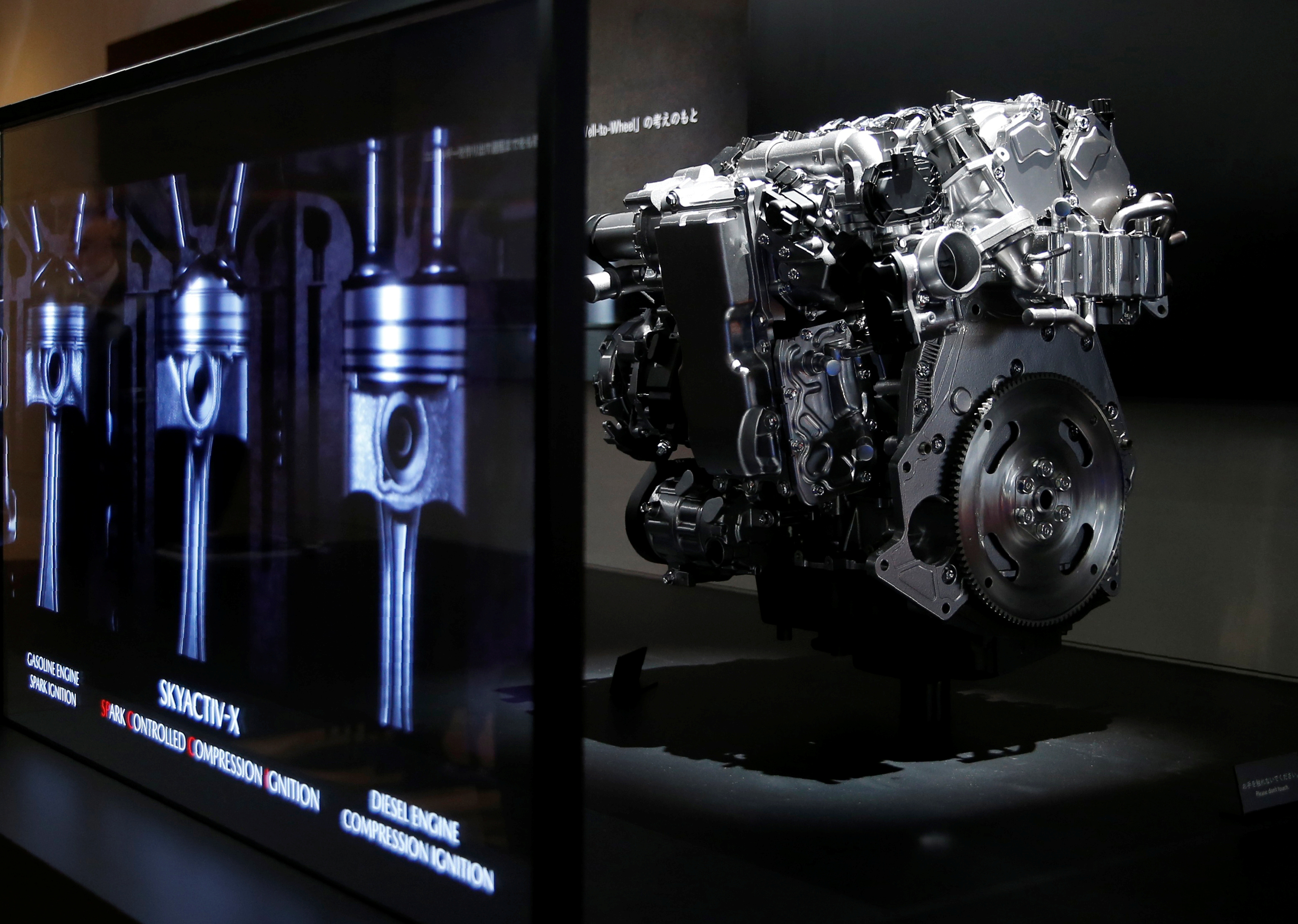 A model of Mazda Motor's newly developed SKYACTIV-X engine is displayed during media preview of the 45th Tokyo Motor Show in Tokyo