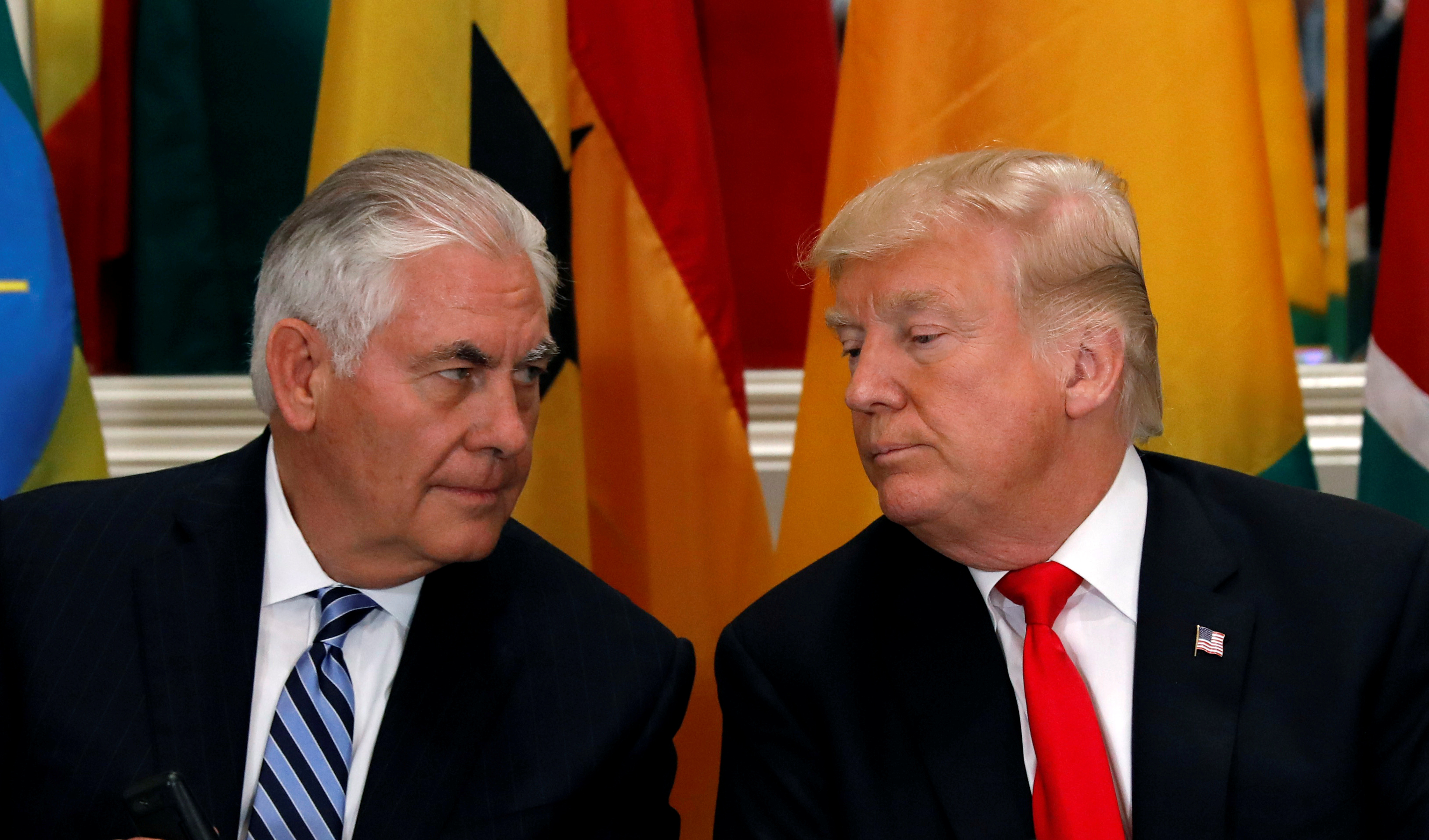 FILE PHOTO: U.S. President Donald Trump and Secretary of State Rex Tillerson confer during a working lunch in New York