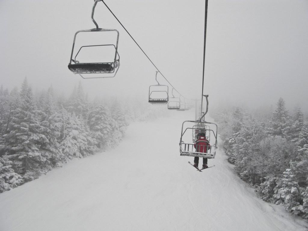 USA, Vermont, Killington, Skier on chair lift