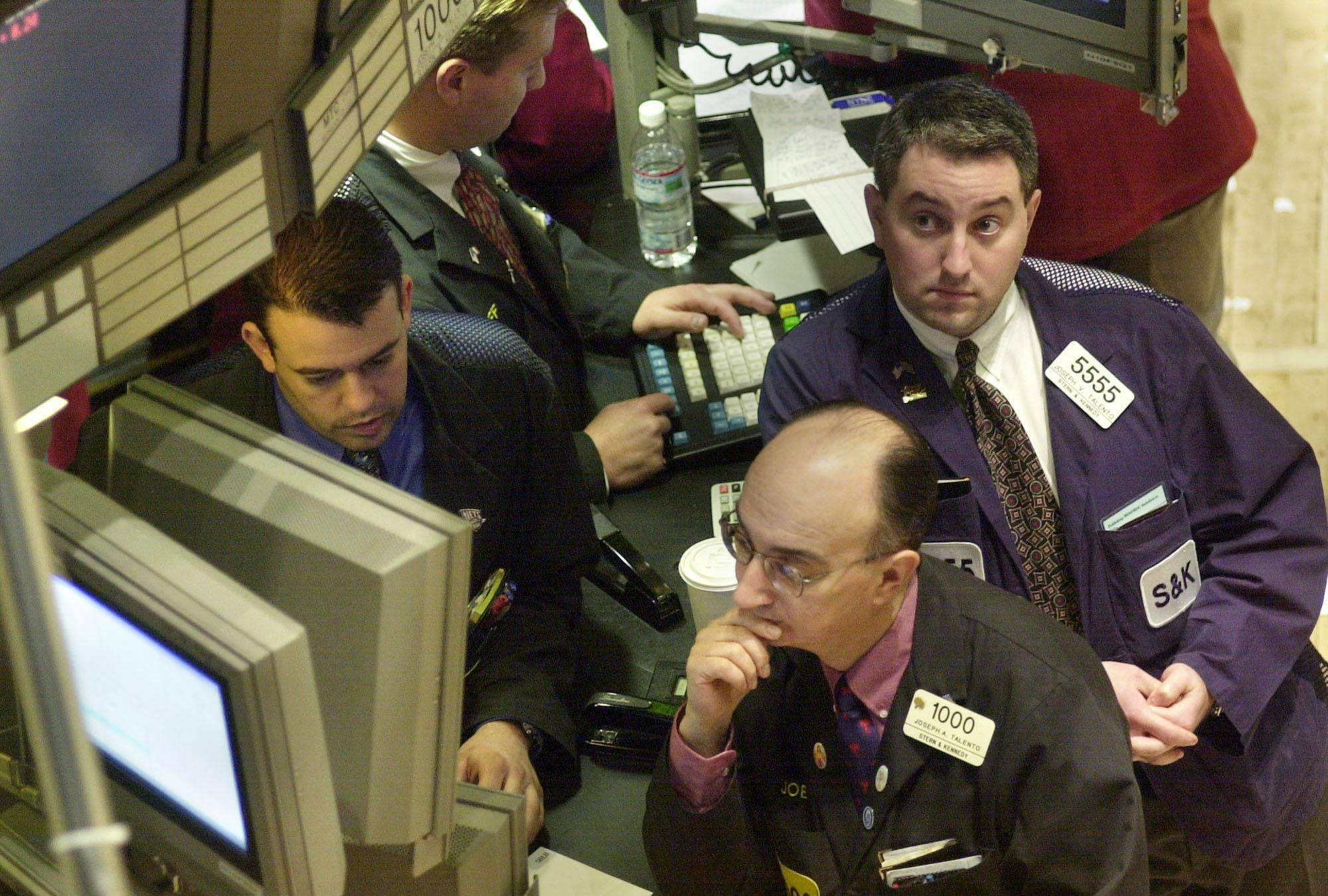 Stock investors watching stock prices fall during a market crash.