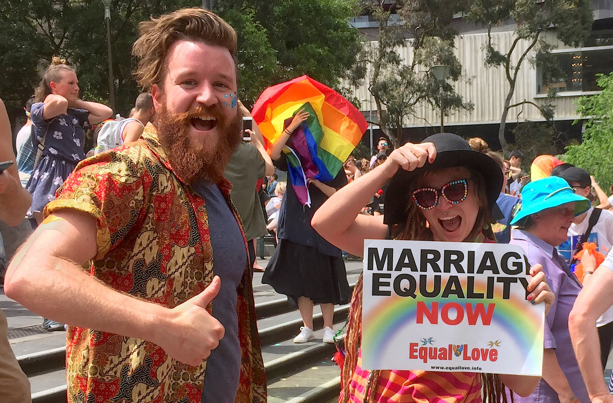 Supporters of the 'Yes' vote react as they celebrate after it was announced the majority of Australians support same-sex marriage in a national survey, at a rally in Sydney