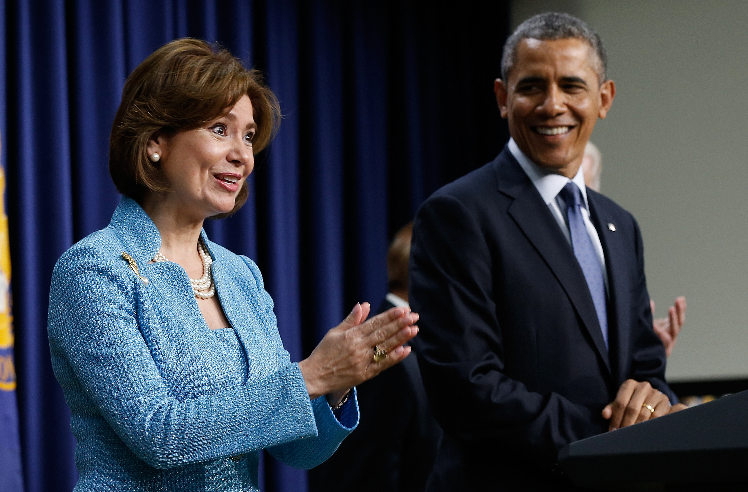 Maria Contreras-Sweet stands next to President Barack Obama at her swearing-in as Small Business Administration Chief